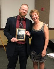 Matt Lovitz, left, receives the Sertoman of the Year award from St. Cloud Area Sertoma President Dede Budde.