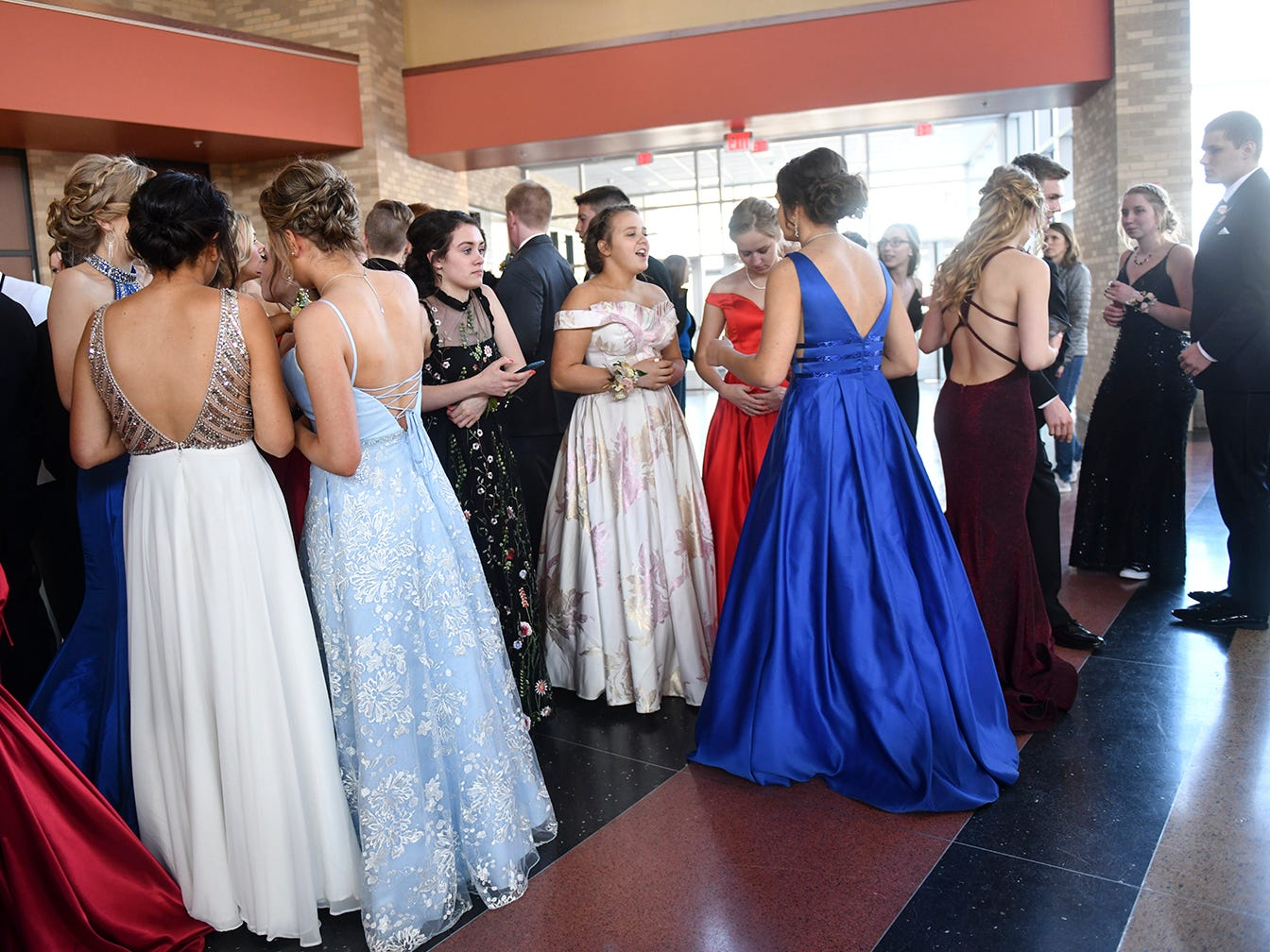 Promgoers line up before the start of prom grand march Saturday, April 13, at ROCORI High School in Cold Spring.