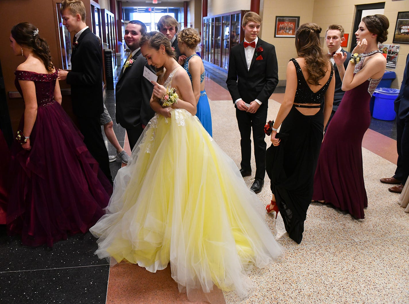 Jaida Vogel and Tucker Reme get ready for their turn at prom grand march Saturday, April 13, at ROCORI High School in Cold Spring.