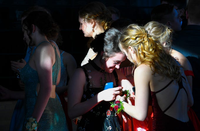 Promgoers gather before the start of prom grand march Saturday, April 13, at ROCORI High School in Cold Spring.