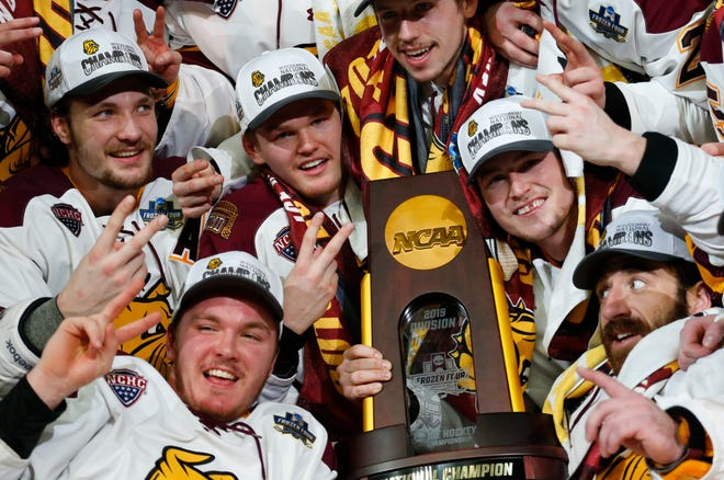 Minnesota-Duluth players celebrate a 3-0 victory over Massachusetts in the NCAA Frozen Four men's college hockey championship game Saturday, April 13, 2019, in Buffalo, N.Y.
