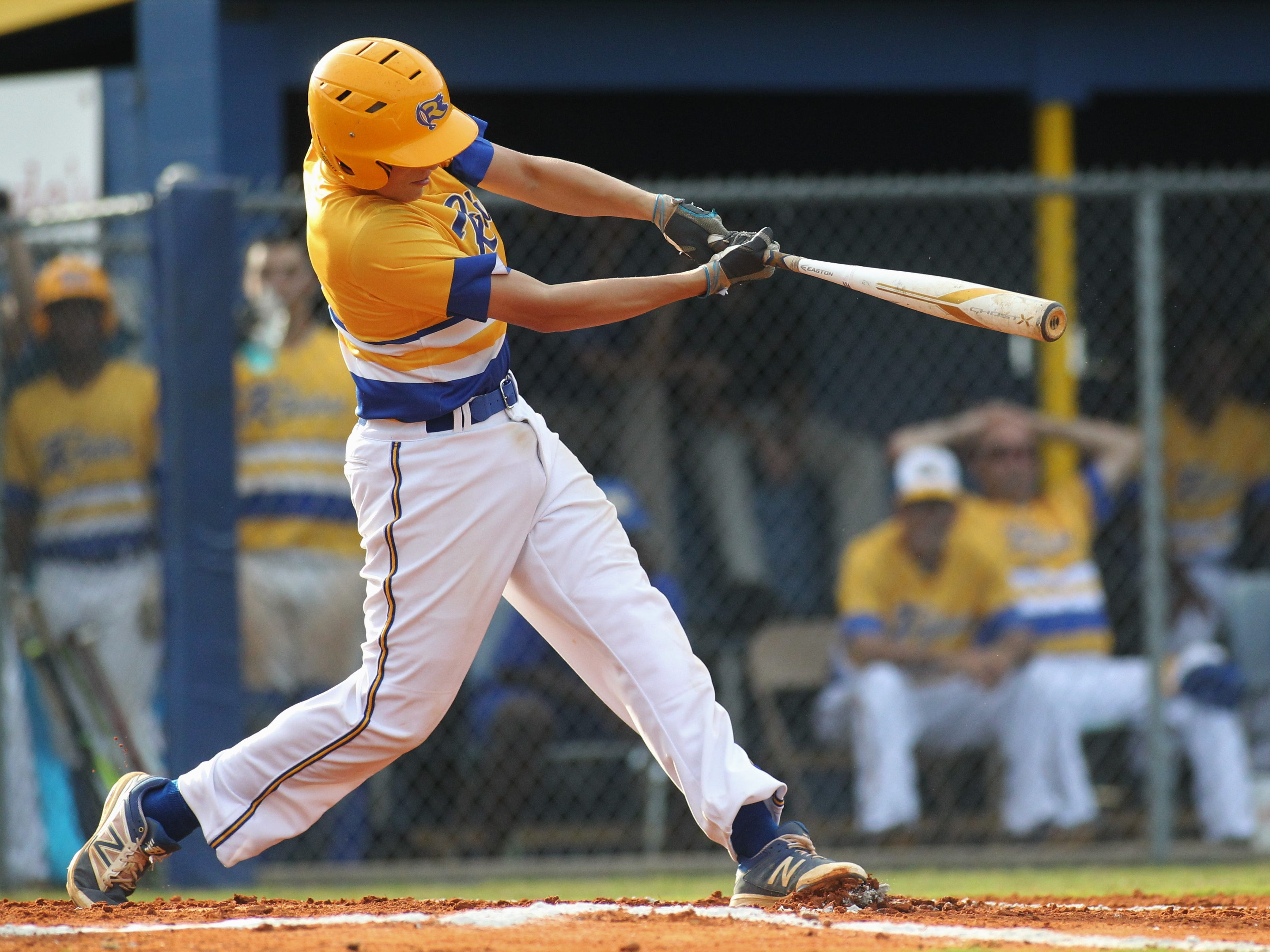 Rickards junior Nevan Figueroa laces a hit as Rickards beat Gadsden County 18-0 in three innings on Friday, April 12, 2019.