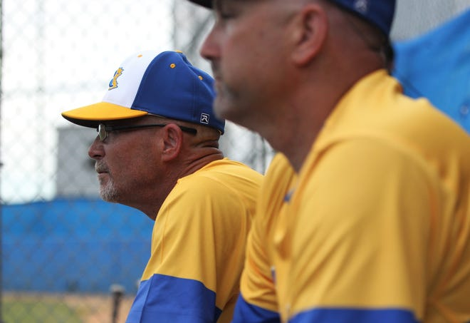 Rickards head coach Brian Kelley watches as the Raiders' baseball team beat Gadsden County 18-0 in three innings on Friday, April 12, 2019.