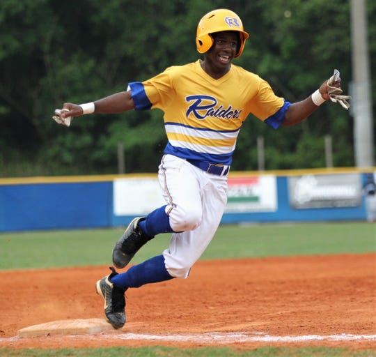 Rickards senior Demarkus Soloman rounds third to score a run as Rickards beat Gadsden County 18-0 in three innings on Friday, April 12, 2019.