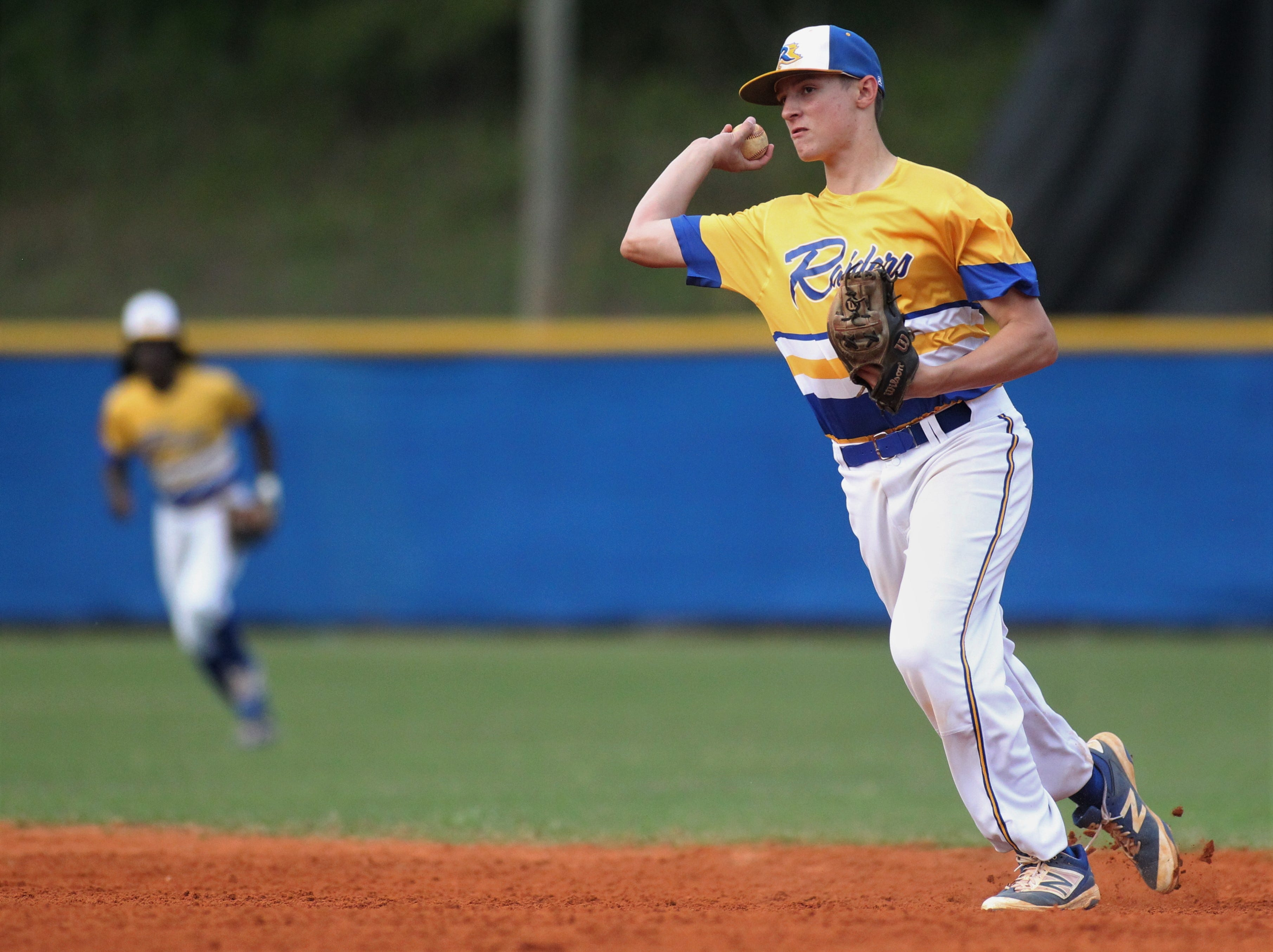 Rickards second baseman Nevan Figueroa throws to first for an out as Rickards beat Gadsden County 18-0 in three innings on Friday, April 12, 2019.