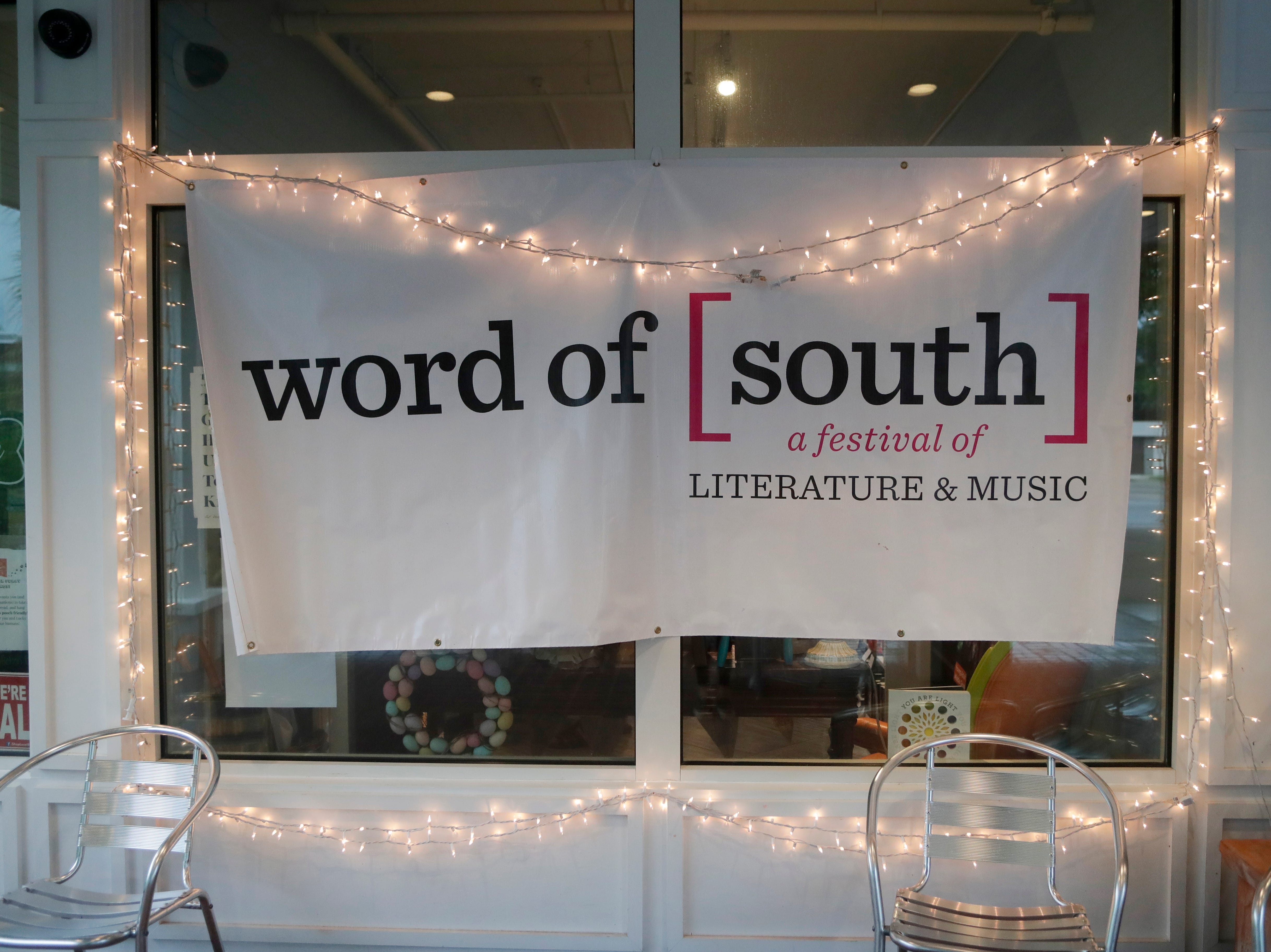 A Word of South banner hangs in front of Midtown Reader during the festival Sunday, April 14, 2019.