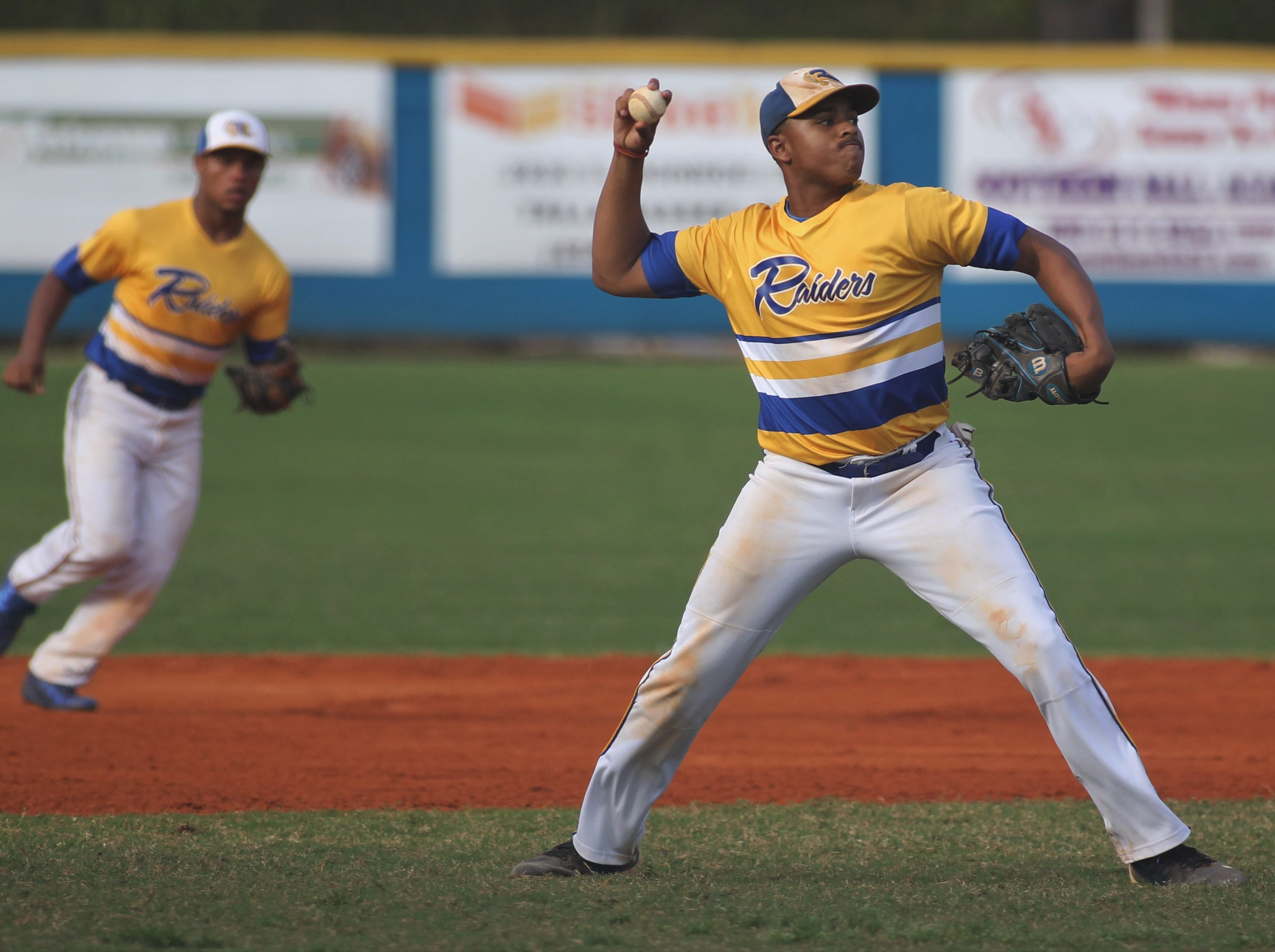Rickards senior third baseman Norris Leland throws to first for an out as Rickards beat Gadsden County 18-0 in three innings on Friday, April 12, 2019.
