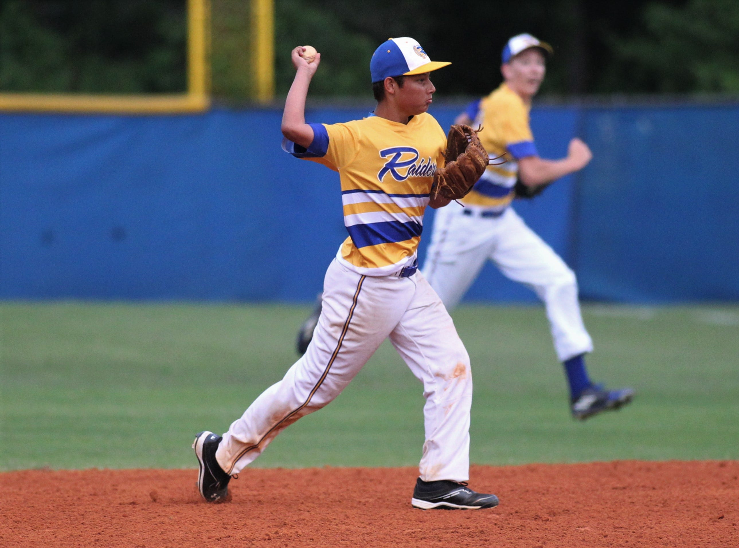 Rickards junior second baseman Dylan Butterfield throws to first for a final out as Rickards beat Gadsden County 18-0 in three innings on Friday, April 12, 2019.