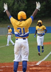Rickards sophomore Kaleb Henry gets welcome to home plate after a home run as Rickards beat Gadsden County 18-0 in three innings on Friday, April 12, 2019.