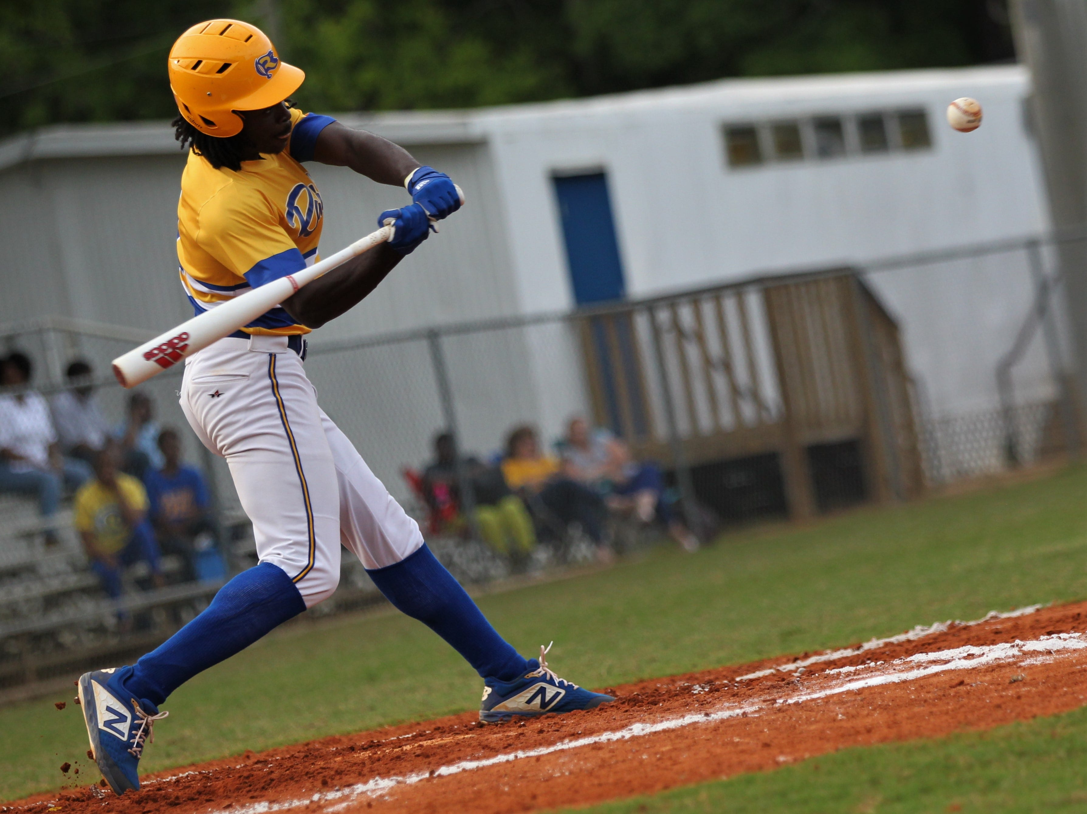 Rickards sophomore Kaleb Henry makes a home run swing as Rickards beat Gadsden County 18-0 in three innings on Friday, April 12, 2019.