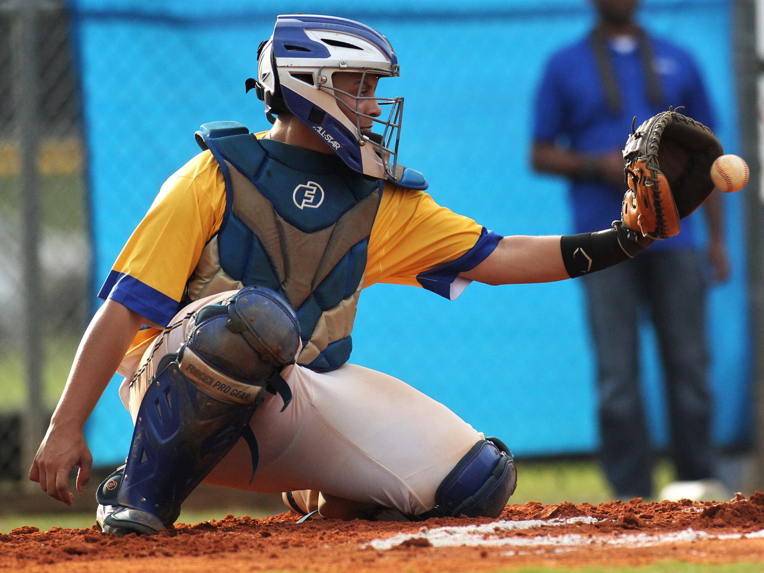 Rickards junior catcher Jayden Figueroa catches a pitch as Rickards beat Gadsden County 18-0 in three innings on Friday, April 12, 2019.