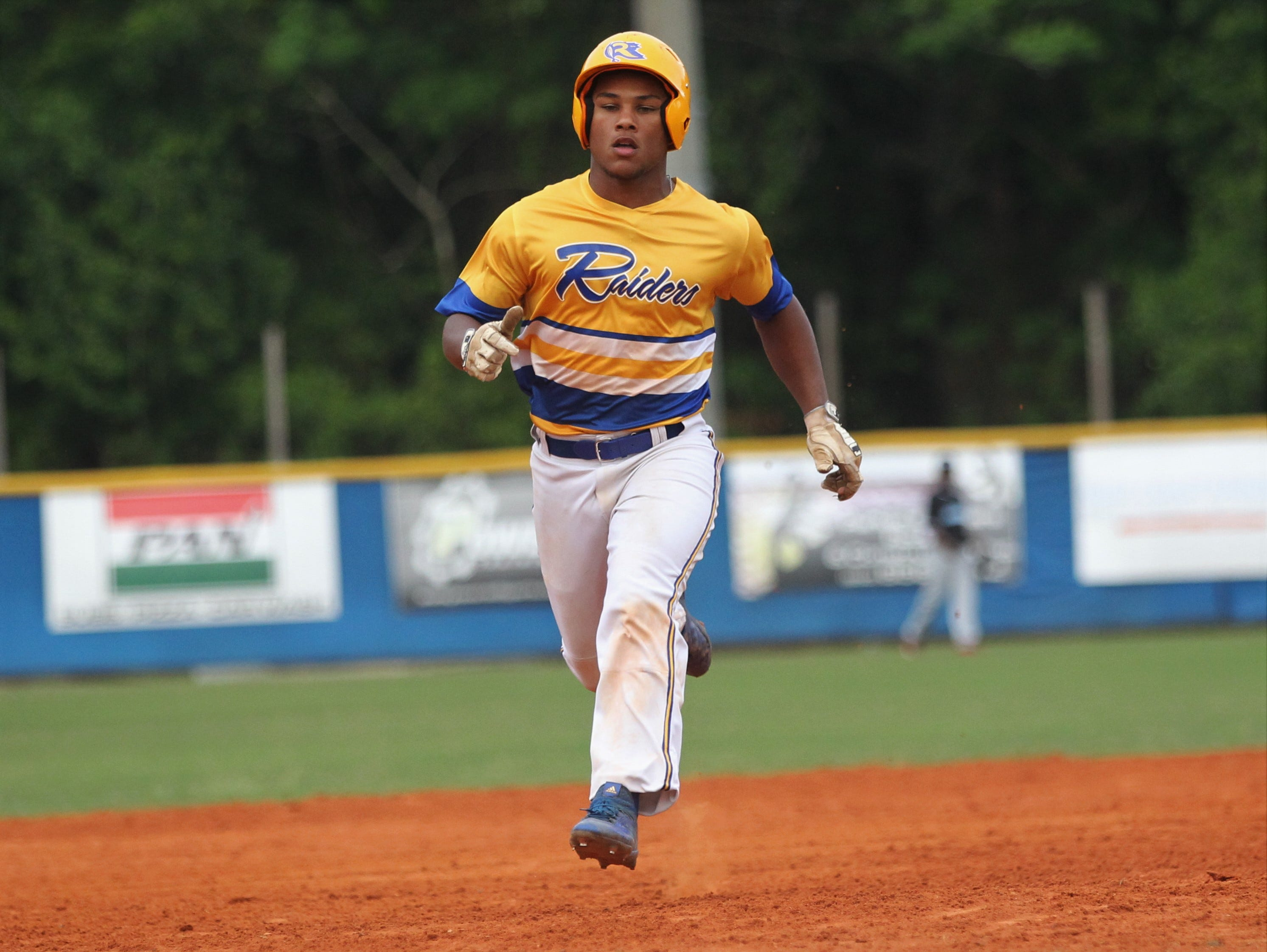 Rickards sophomore Will Brown trots into third with a triple as Rickards beat Gadsden County 18-0 in three innings on Friday, April 12, 2019.