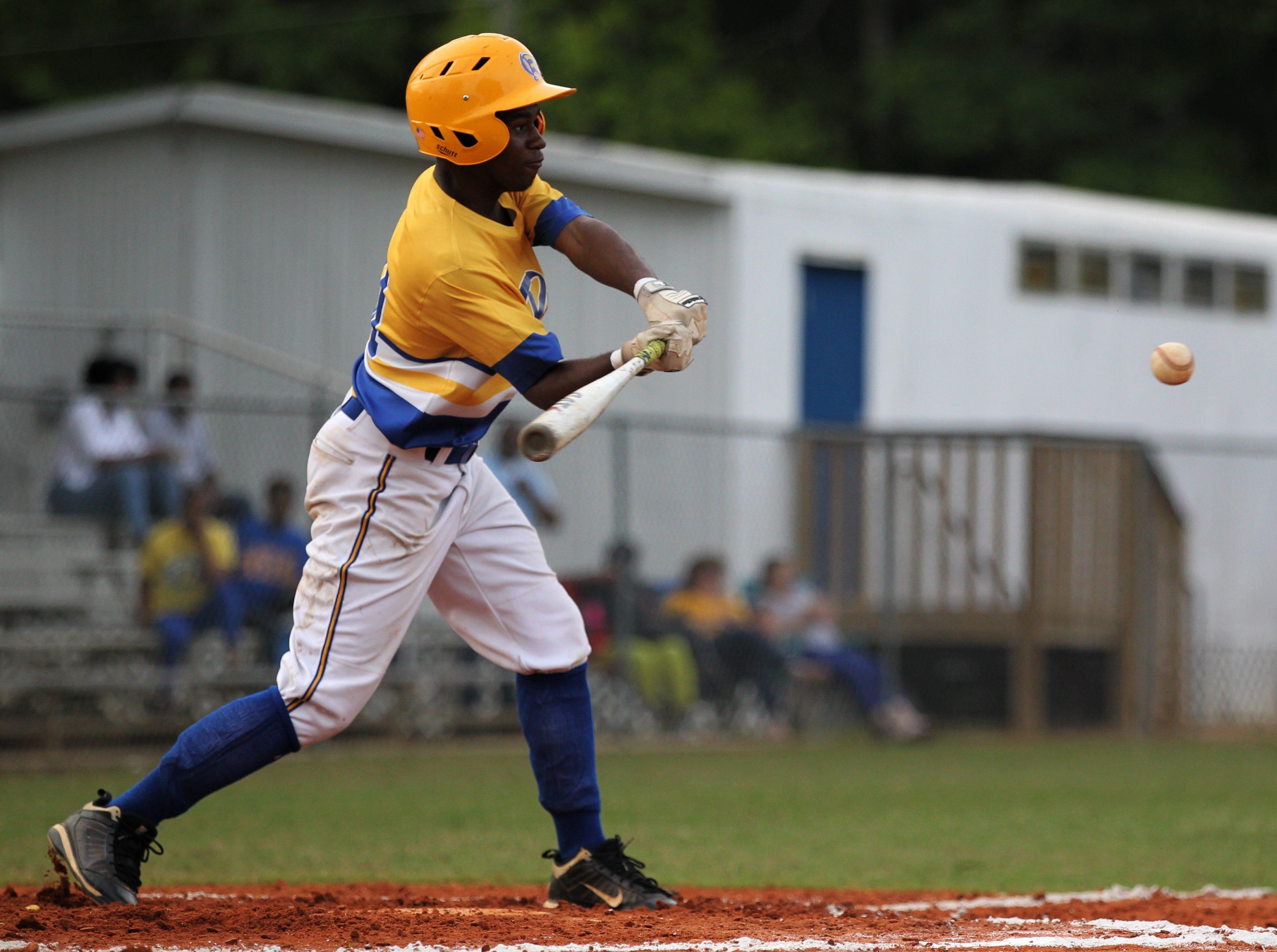 Rickards' Jermaine Walker bats as Rickards beat Gadsden County 18-0 in three innings on Friday, April 12, 2019.
