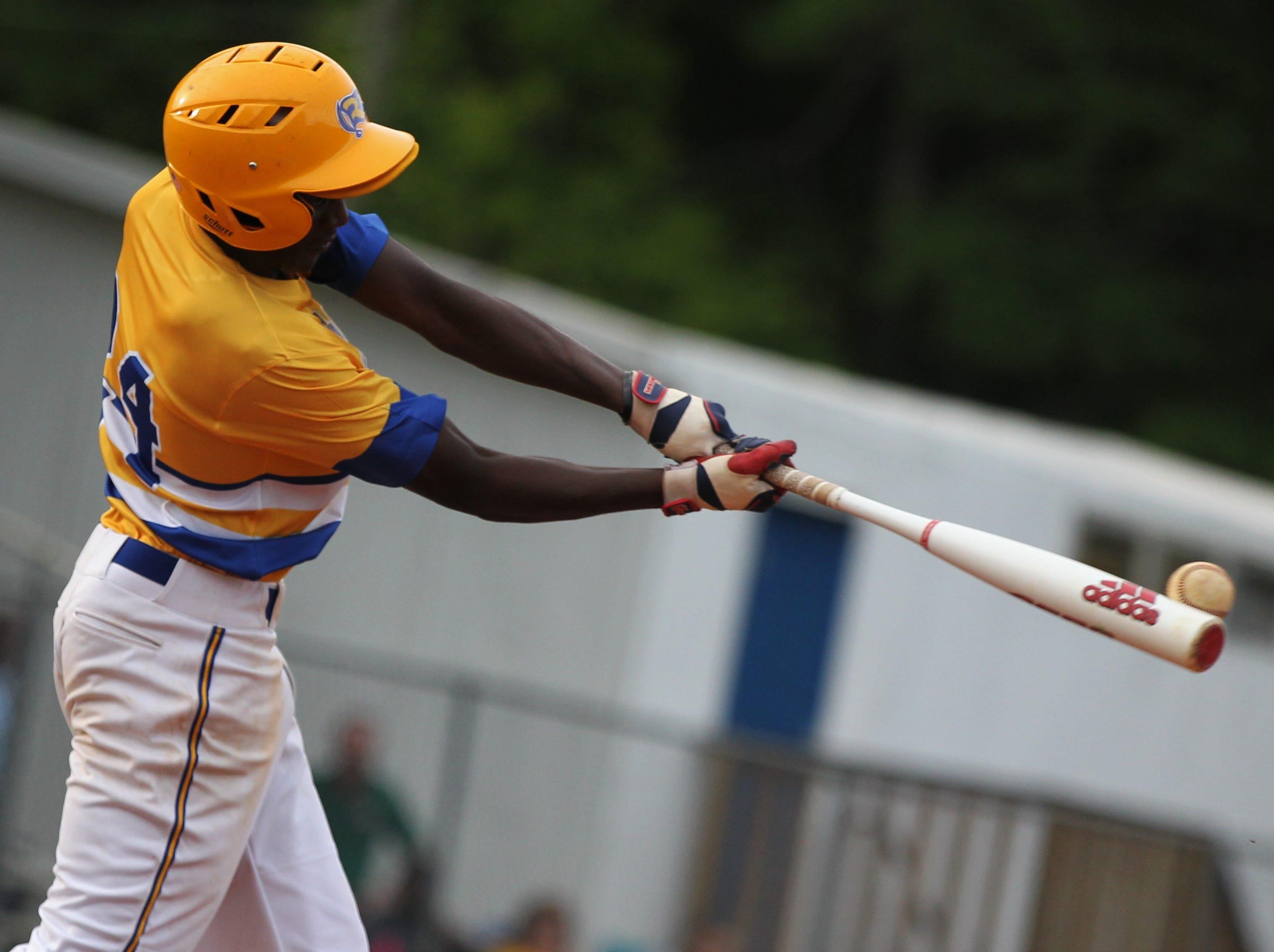 Rickards junior Jermaine Walker bats as Rickards beat Gadsden County 18-0 in three innings on Friday, April 12, 2019.