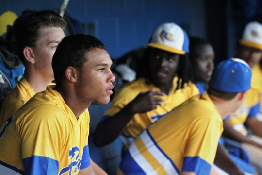 Rickards sophomore Will Brown watches as Rickards beat Gadsden County 18-0 in three innings on Friday, April 12, 2019.
