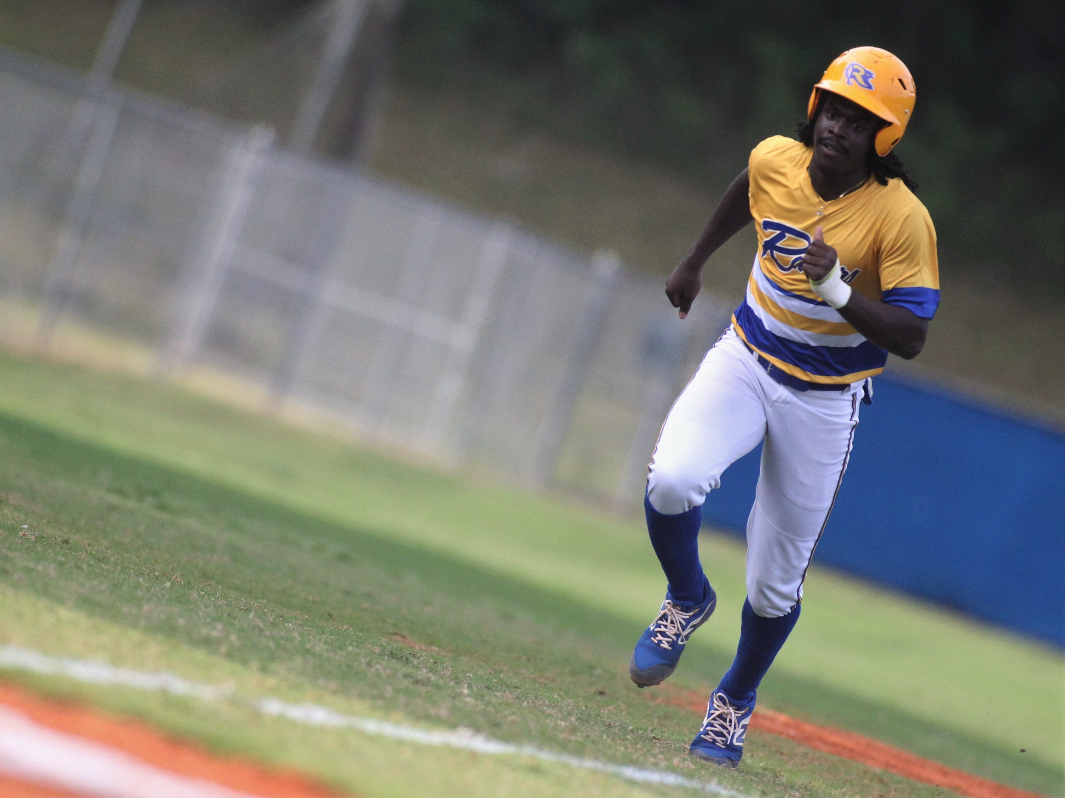 Rickards sophomore Kaleb Henry trots home to score a run as Rickards beat Gadsden County 18-0 in three innings on Friday, April 12, 2019.