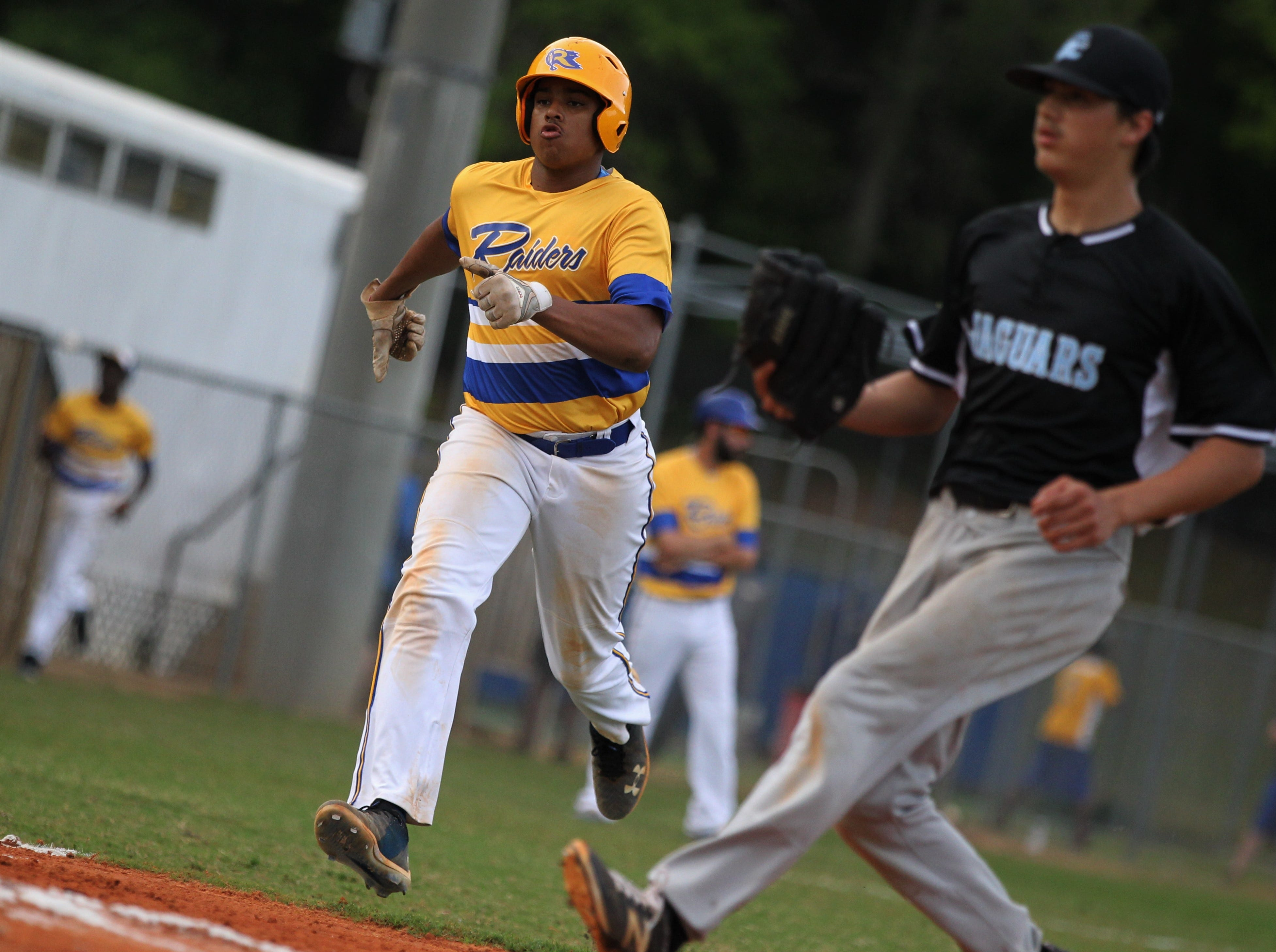 Rickards senior Norris Leland scores a run as Rickards beat Gadsden County 18-0 in three innings on Friday, April 12, 2019.
