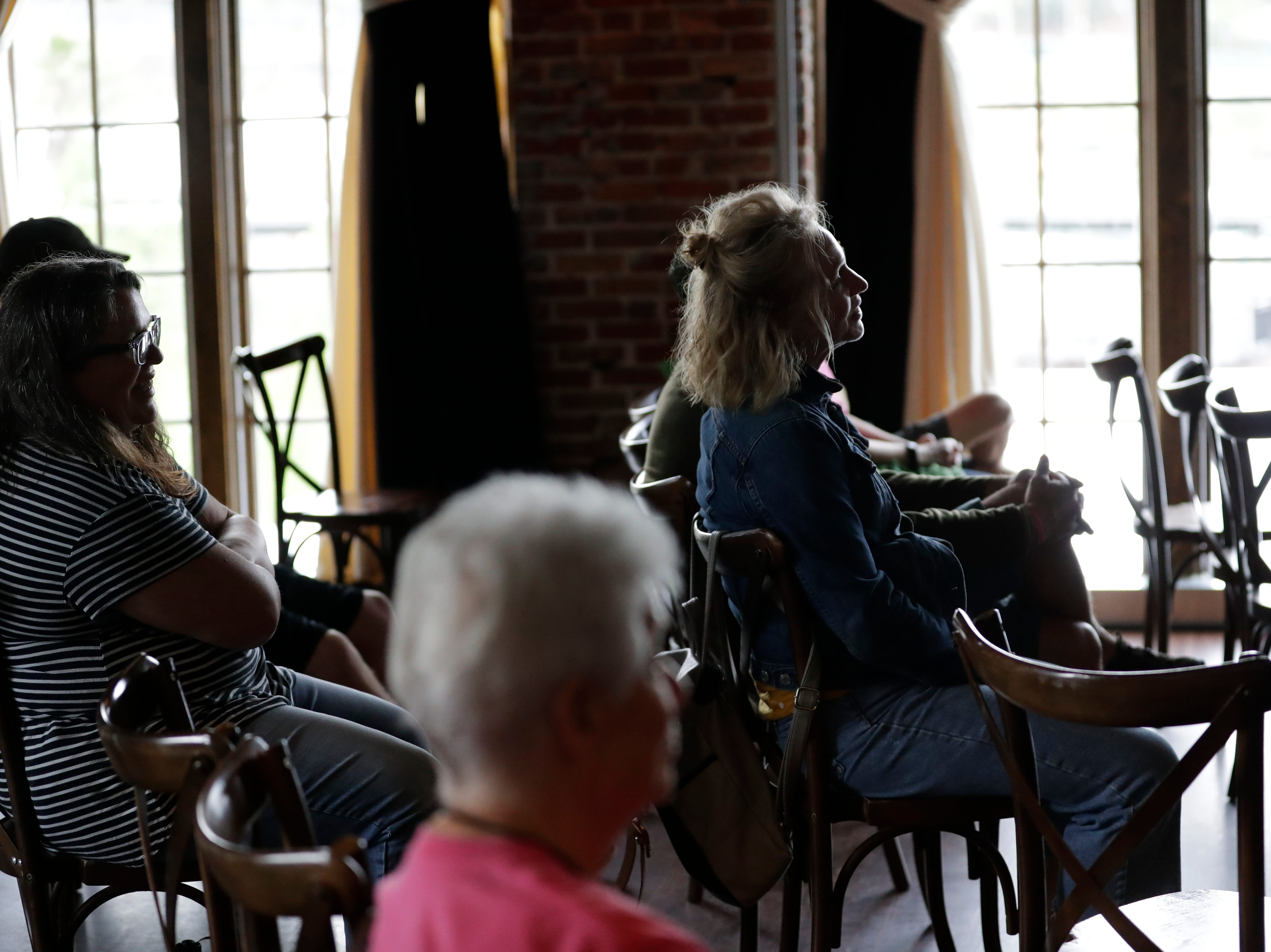 "The audience listens as Maria Dahvana Headley reads an excerpt from her book ""The Mere Wife"" at The Edison during the Word of South festival Sunday, April 14, 2019."