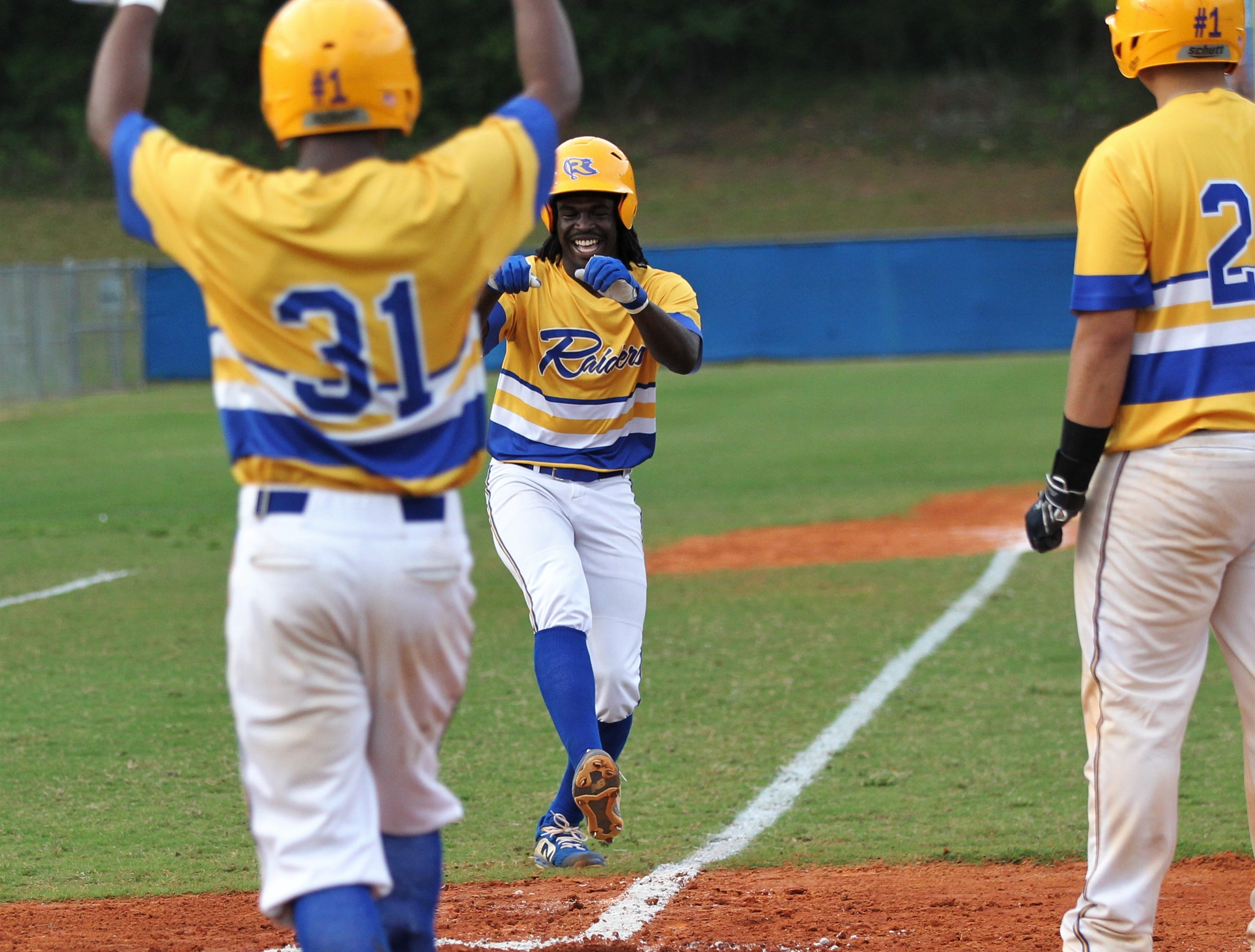 Rickards sophomore Kaleb Henry revs up at home plate after hitting a home run as Rickards beat Gadsden County 18-0 in three innings on Friday, April 12, 2019.