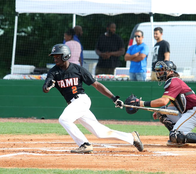 FAMU center fielder Willis McDaniel looks to run out a ground ball in Game 1 of the doubleheader versus B-CU on Saturday, April 13, 2019.