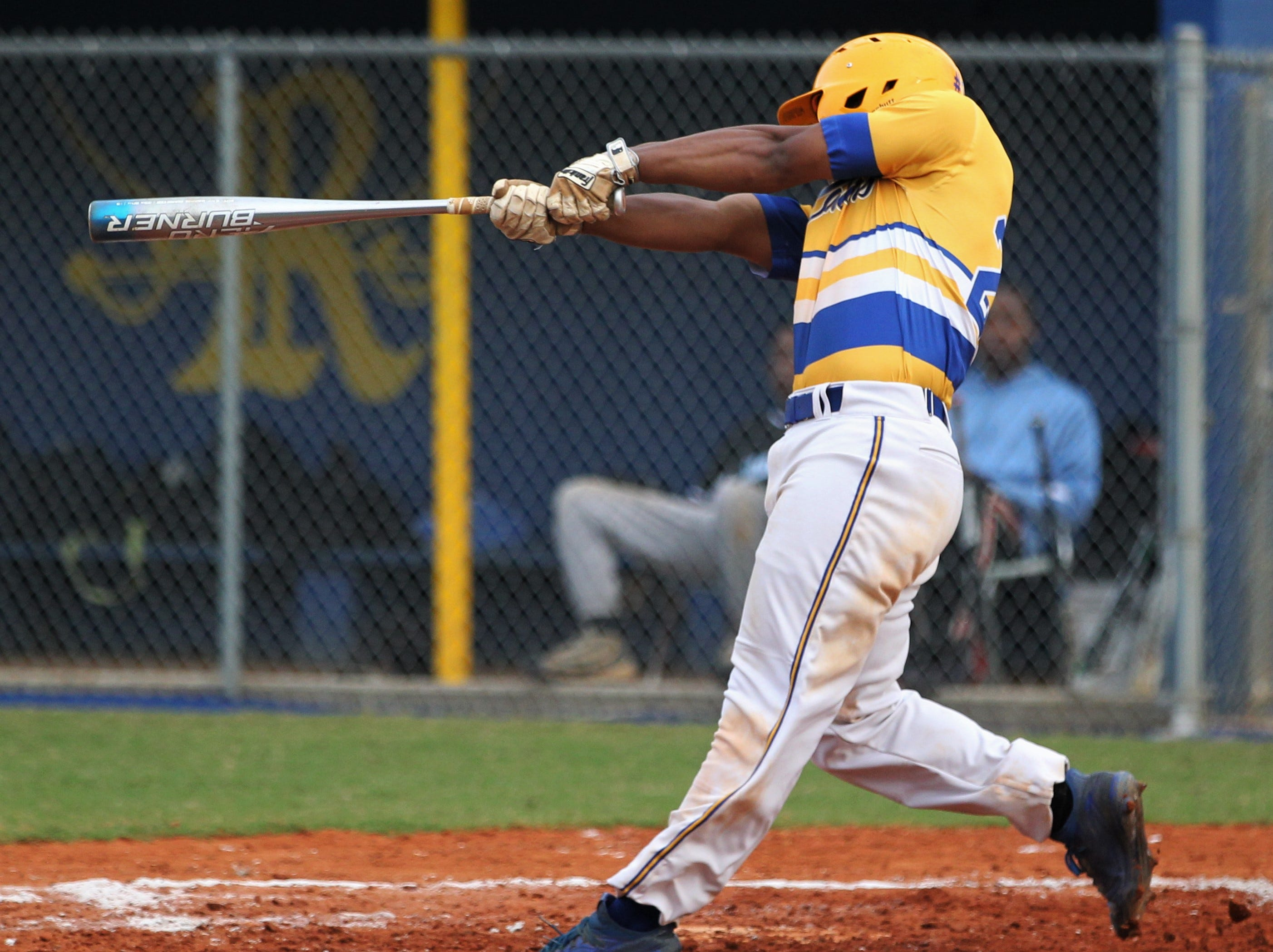 Rickards sophomore Will Brown follows through on a two-run triple as Rickards beat Gadsden County 18-0 in three innings on Friday, April 12, 2019.