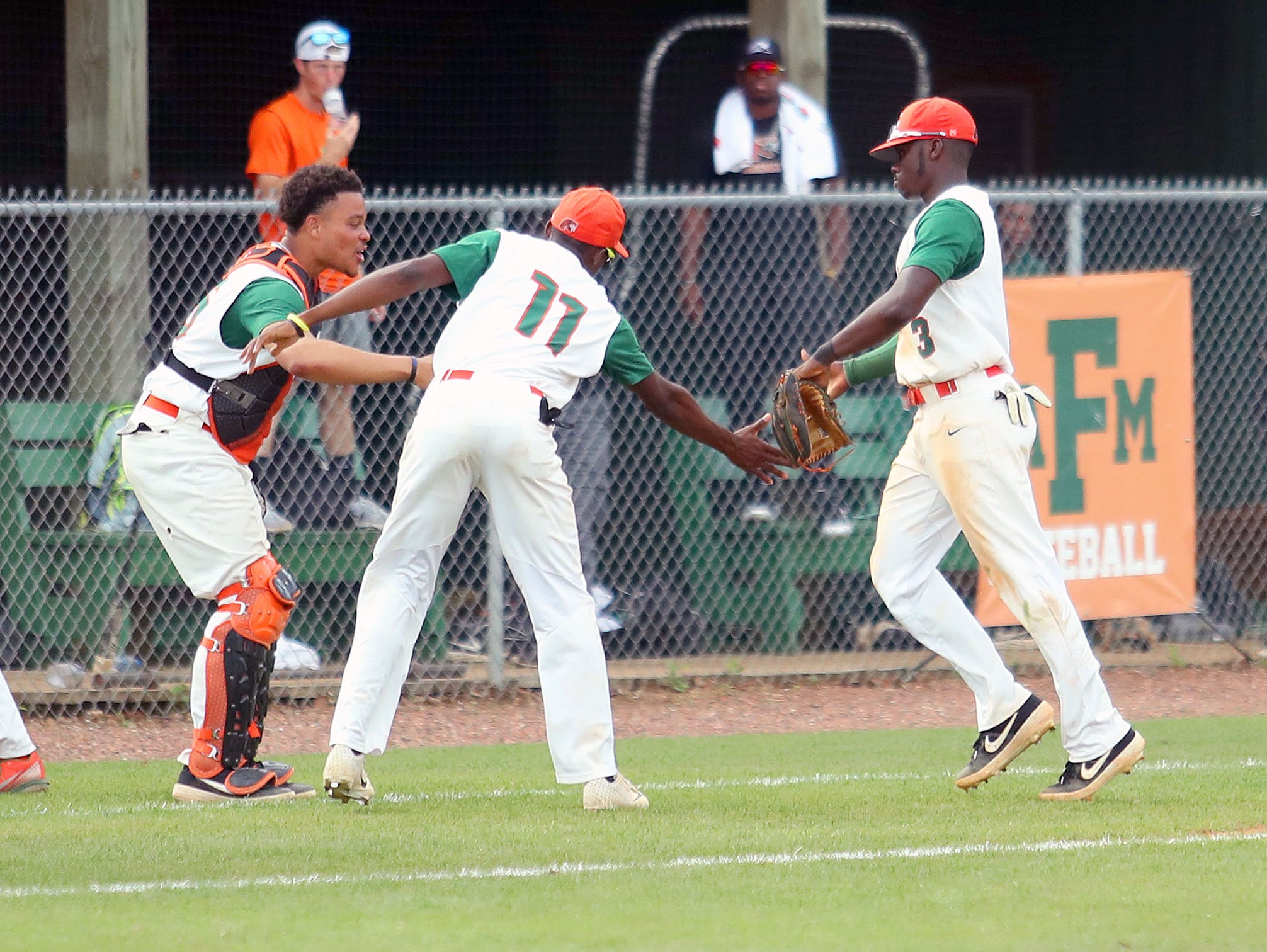 FAMU shortstop Robert Robinson (left) celebrates with teammates between innings in Game 2 of a doubleheader versus B-CU on Saturday, April 13, 2019.