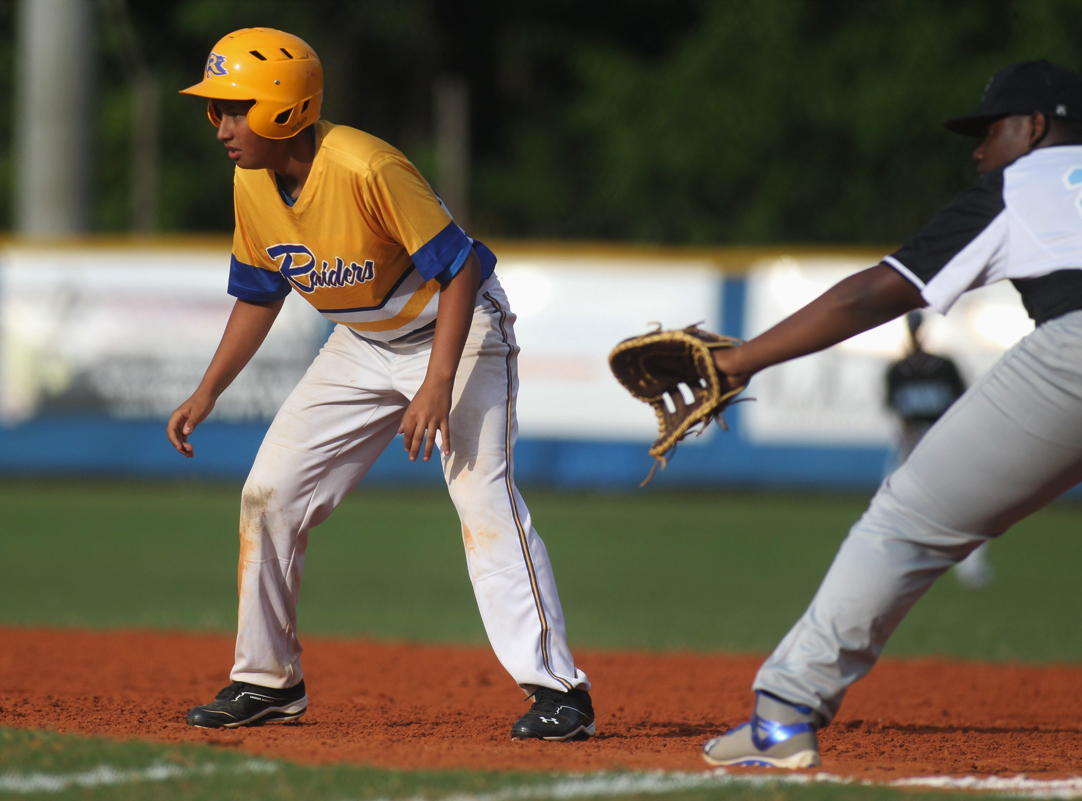 Rickards junior Dylan Butterfield leads off first as Rickards beat Gadsden County 18-0 in three innings on Friday, April 12, 2019.