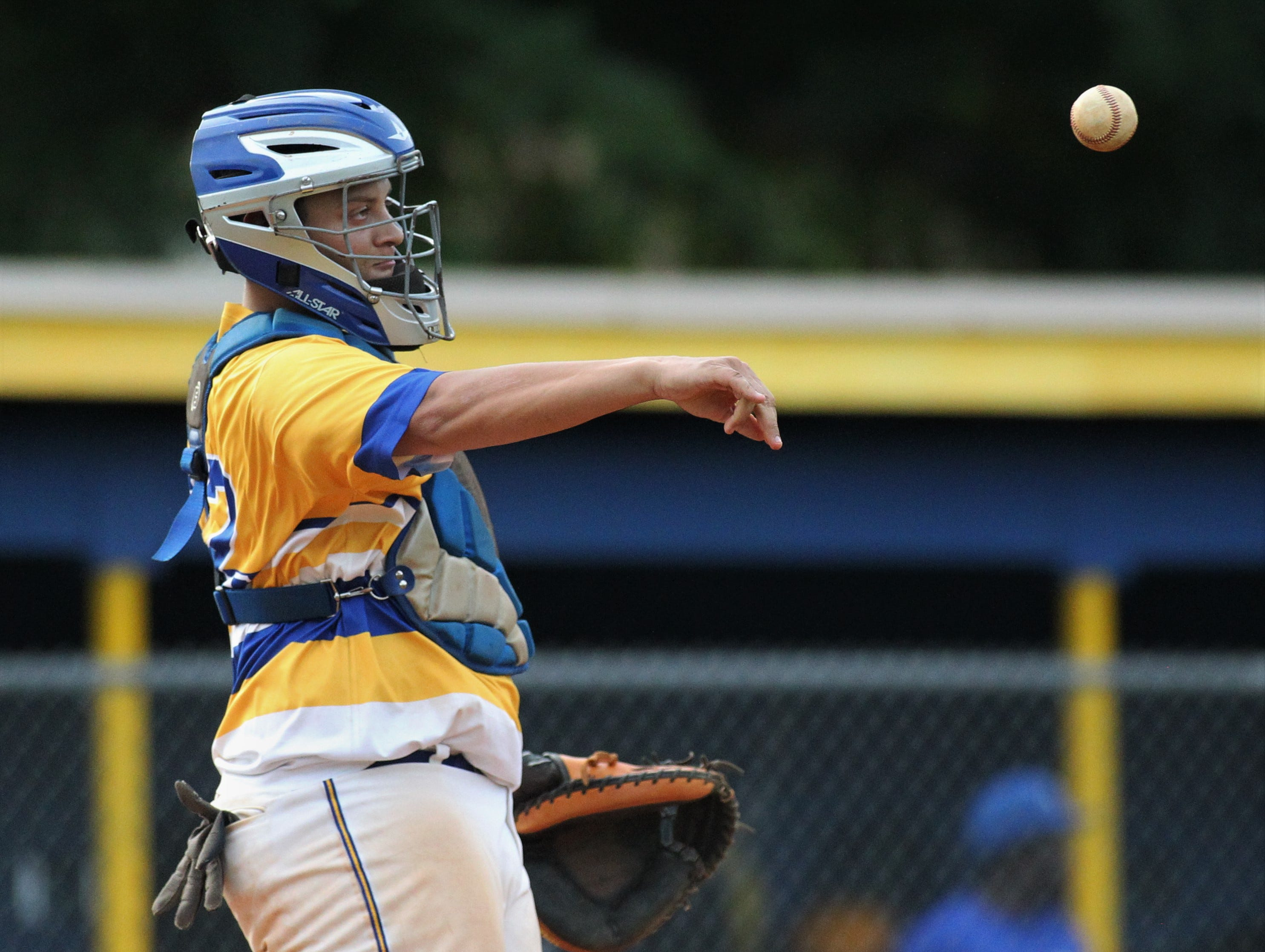 Rickards junior catcher Jayden Figueroa throws a ball back to the mound as Rickards beat Gadsden County 18-0 in three innings on Friday, April 12, 2019.
