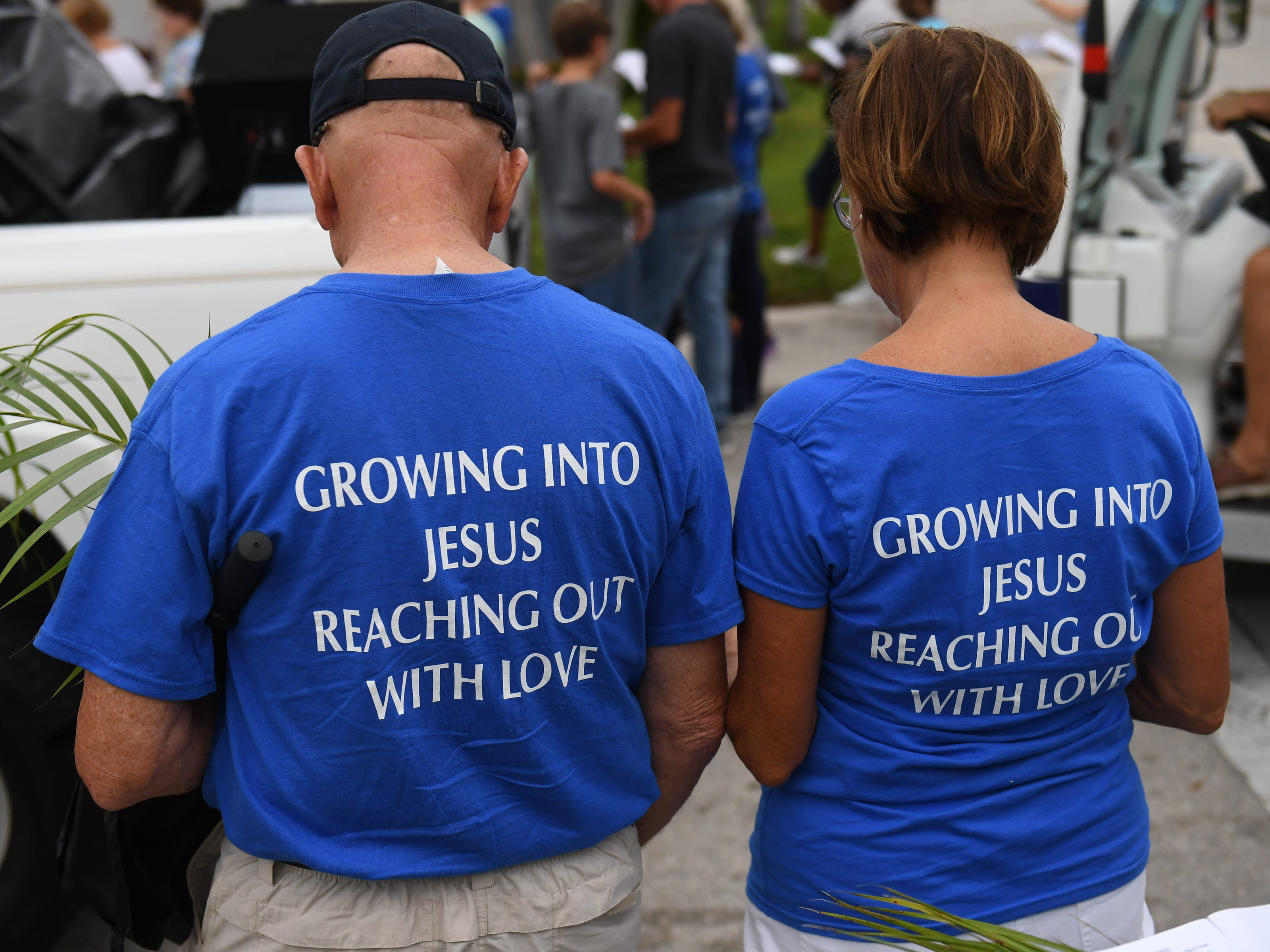 Third annual Neighborhood Stations of the Cross prayer walk on Palm Sunday, April 14, 2019, in Stuart. Christians from more than ten area churches walked through streets in Stuart singing and praying, stopping to pray and recite scripture at ten locations, carrying the cross from St. Monica's Episcopal Church in East Stuart to St. Mary's Episcopal Church on Ocean Boulevard.