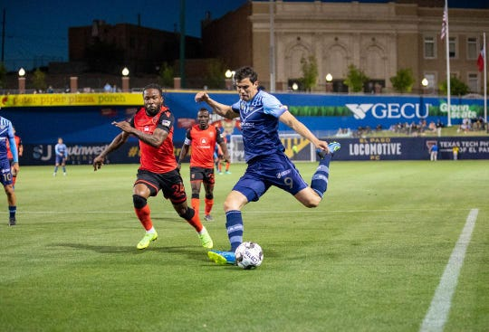 El Paso Locomotive Omar Salgado crosses the ball in a loss to Phoenix Rising.
