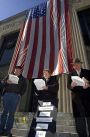 From left, Arthur Soyk of Tappan, the Rev. Susan Auchincloss of St. John's Church in New City, and Rabbi Henry Sosland of the New City Jewish Center recite prayers for peace during a vigil held Tuesday March 11, 2003, on the steps of the old Rockland County Courthouse in New City. The vigil for peace was sponsored by the Clarkstown Clergy Association