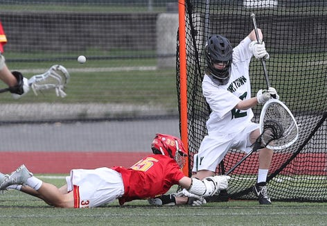 Yorktown goalie Dan O'Meara  (12) blocks a shot by Chaminade's Matthew Major (35) during boys lacrosse action at Yorktown High School April 13,  2019. Chaminade won the game 11-5.