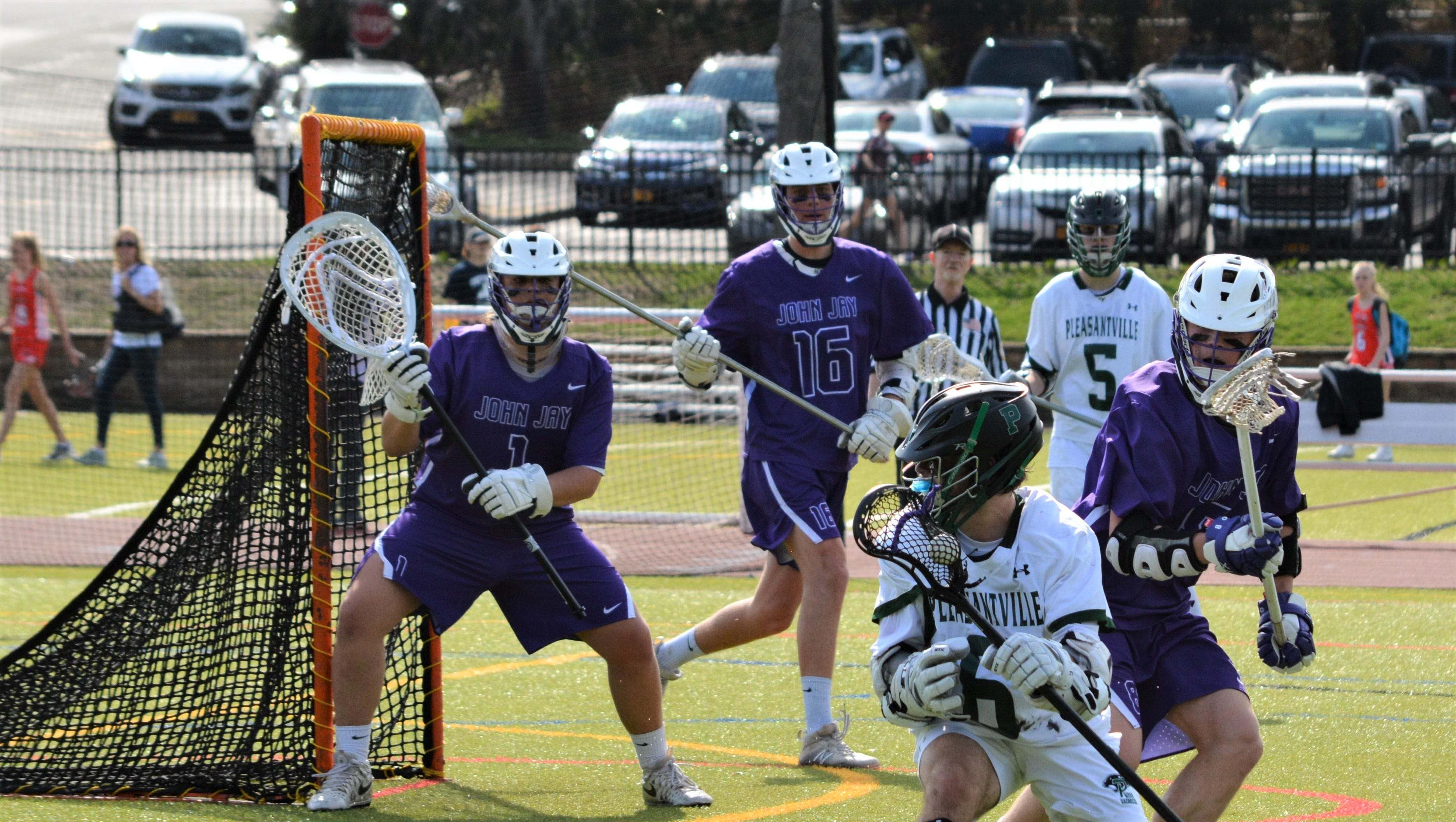 John Jay came back from an 8-6 deficit in the fourth quarter to post an 11-9 win over Pleasantville on Saturday, April 13, 2019.
