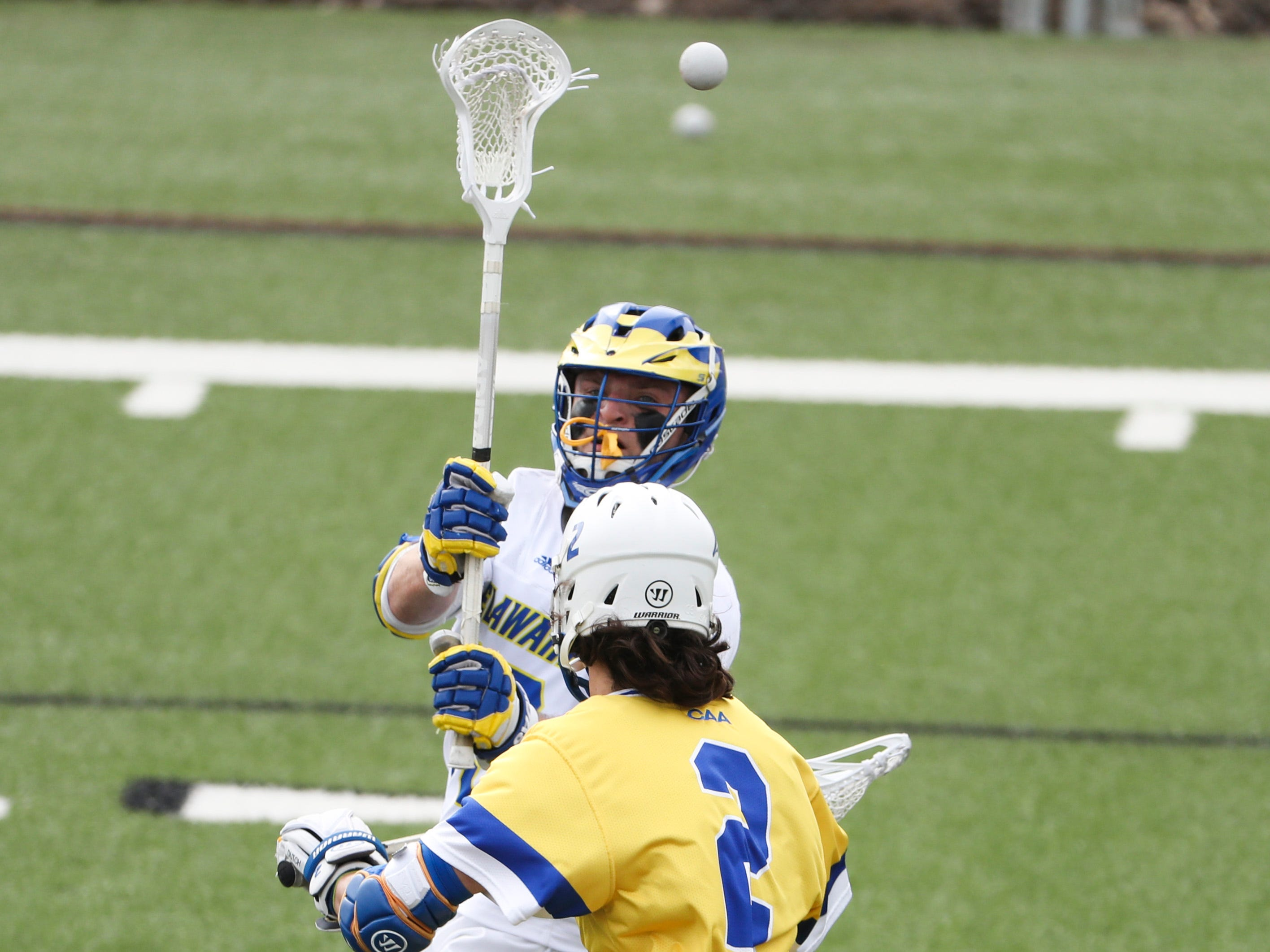 Delaware's Dean DiSimone passes over Hofstra's Corey Kale in the fourth period of Delaware's 13-7 win against rival Hofstra at home Saturday.