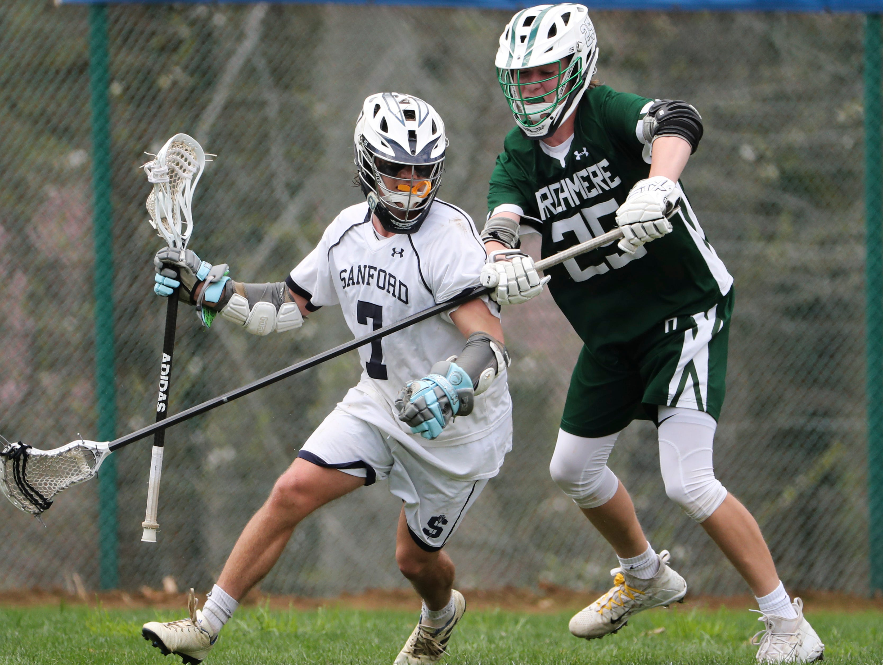 Sanford's Tommy Bloom is defended by Archmere's Nathan Yanick in the second half of Sanford's 12-10 win Saturday.