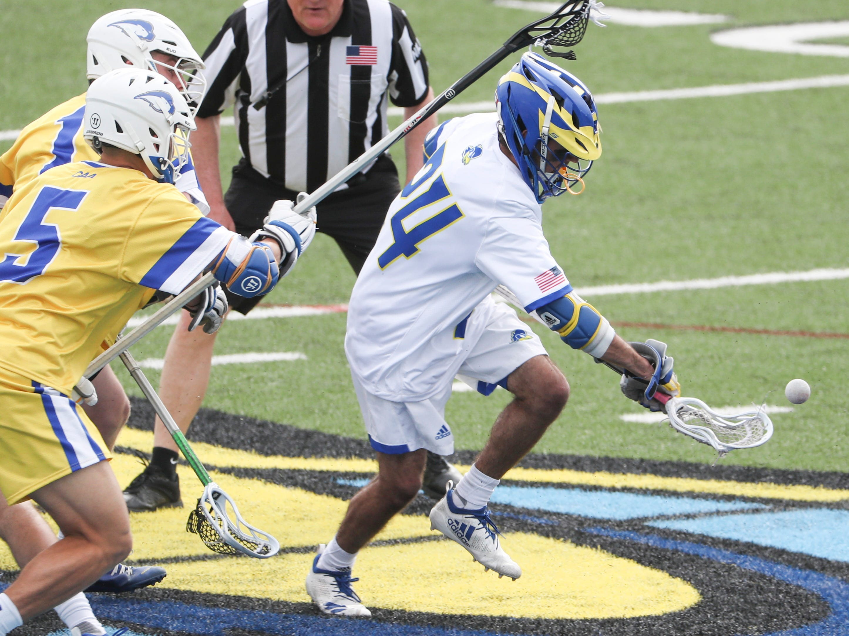 Delaware's Joe Lenskold comes away with the ball on a face-off in the fourth period of Delaware's 13-7 win against Hofstra Saturday at Delaware Stadium.
