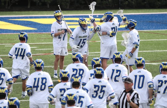Delaware celebrates after dispatching Hofstra 13-7 Saturday at Delaware Stadium.