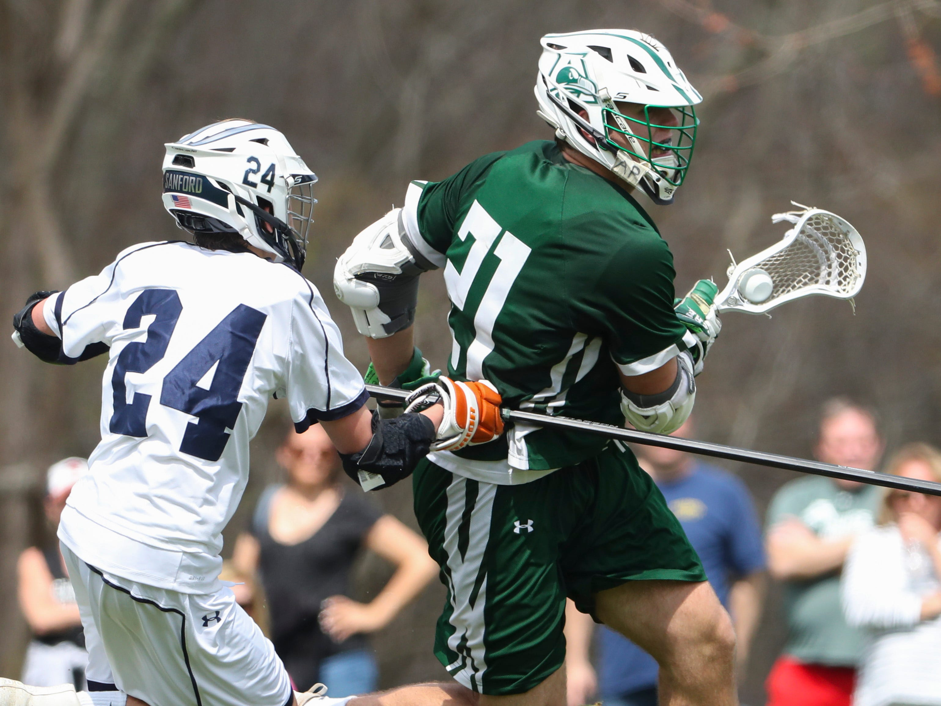 Archmere's Mitch Moyer moves the ball ahead of Sanford's Dominic Pompeii in the second half of Sanford's 12-10 win Saturday.