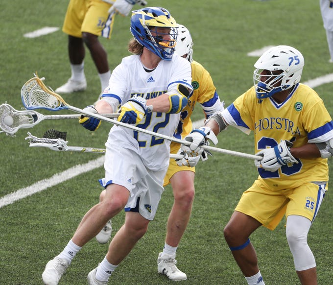 Delaware's Joe Eisele flips a pass in the fourth period of Delaware's 13-7 win against Hofstra Saturday at Delaware Stadium.