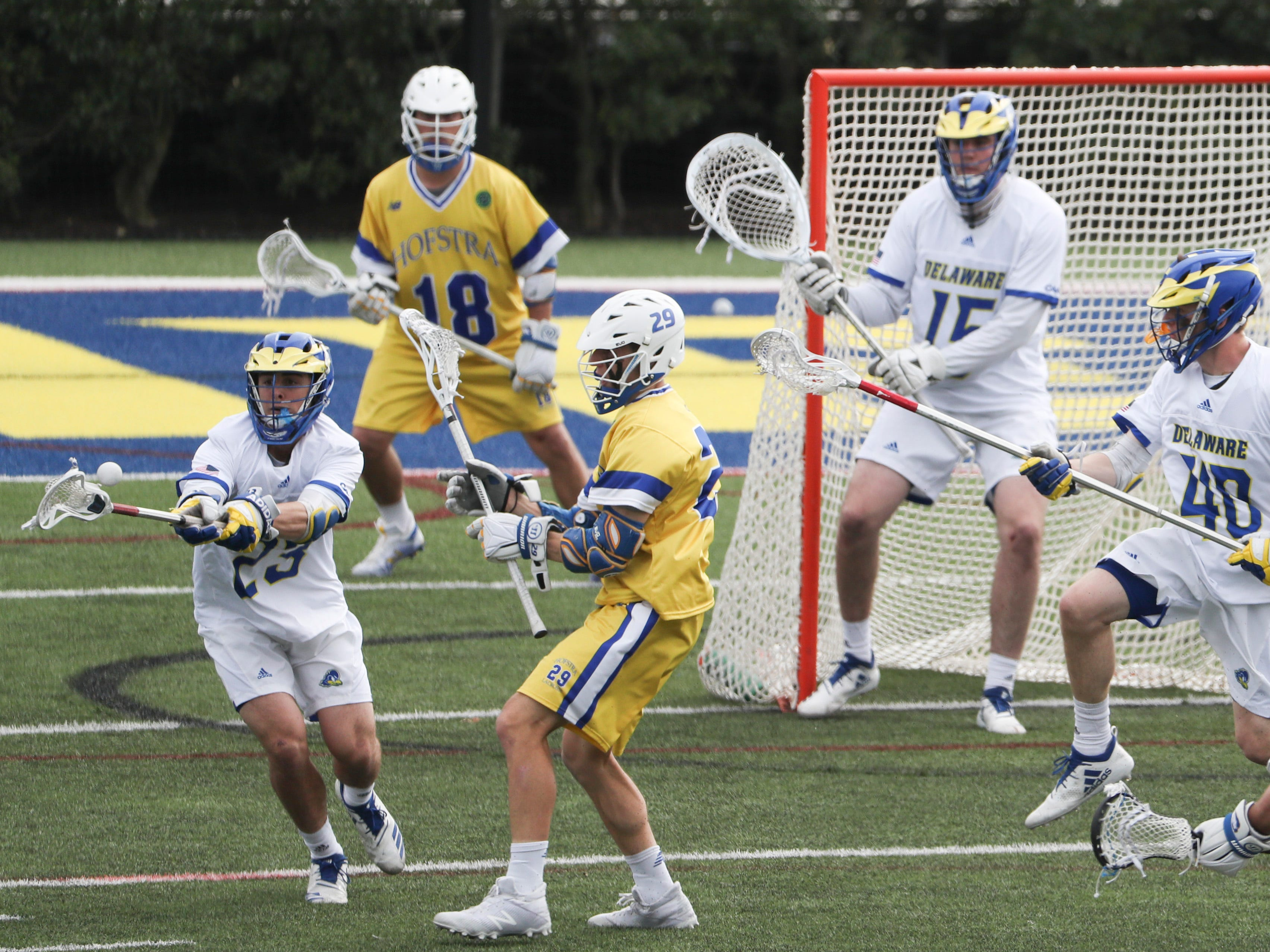 Delaware's Jason Seiter (left) goes for a loose ball on defense in the fourth period of Delaware's 13-7 win against Hofstra Saturday at Delaware Stadium.