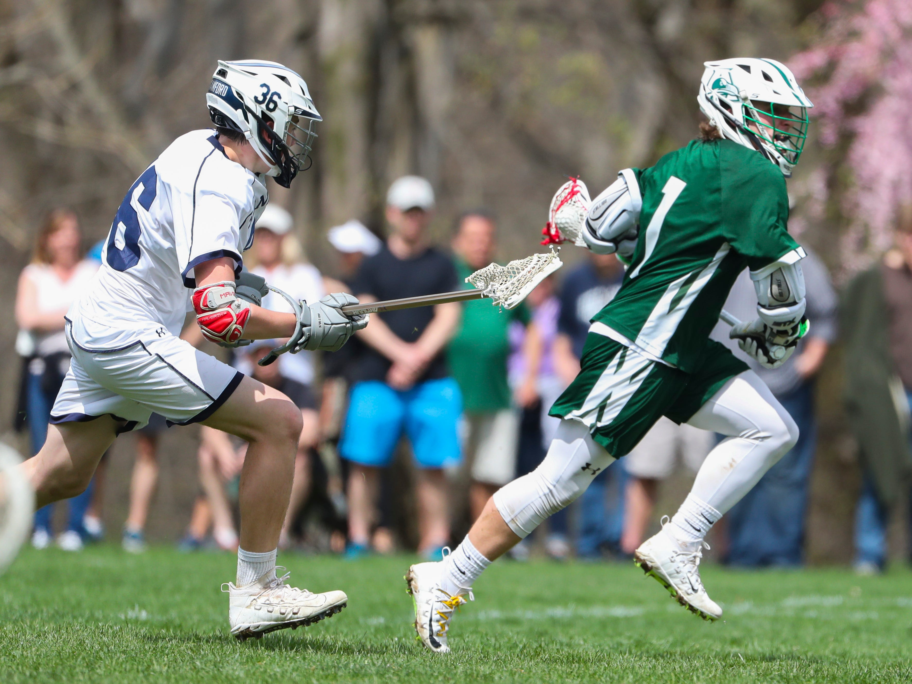 Sanford's Kyle Keller (left) pursues Archmere's Cole Bauer in the second half of Sanford's 12-10 win Saturday.