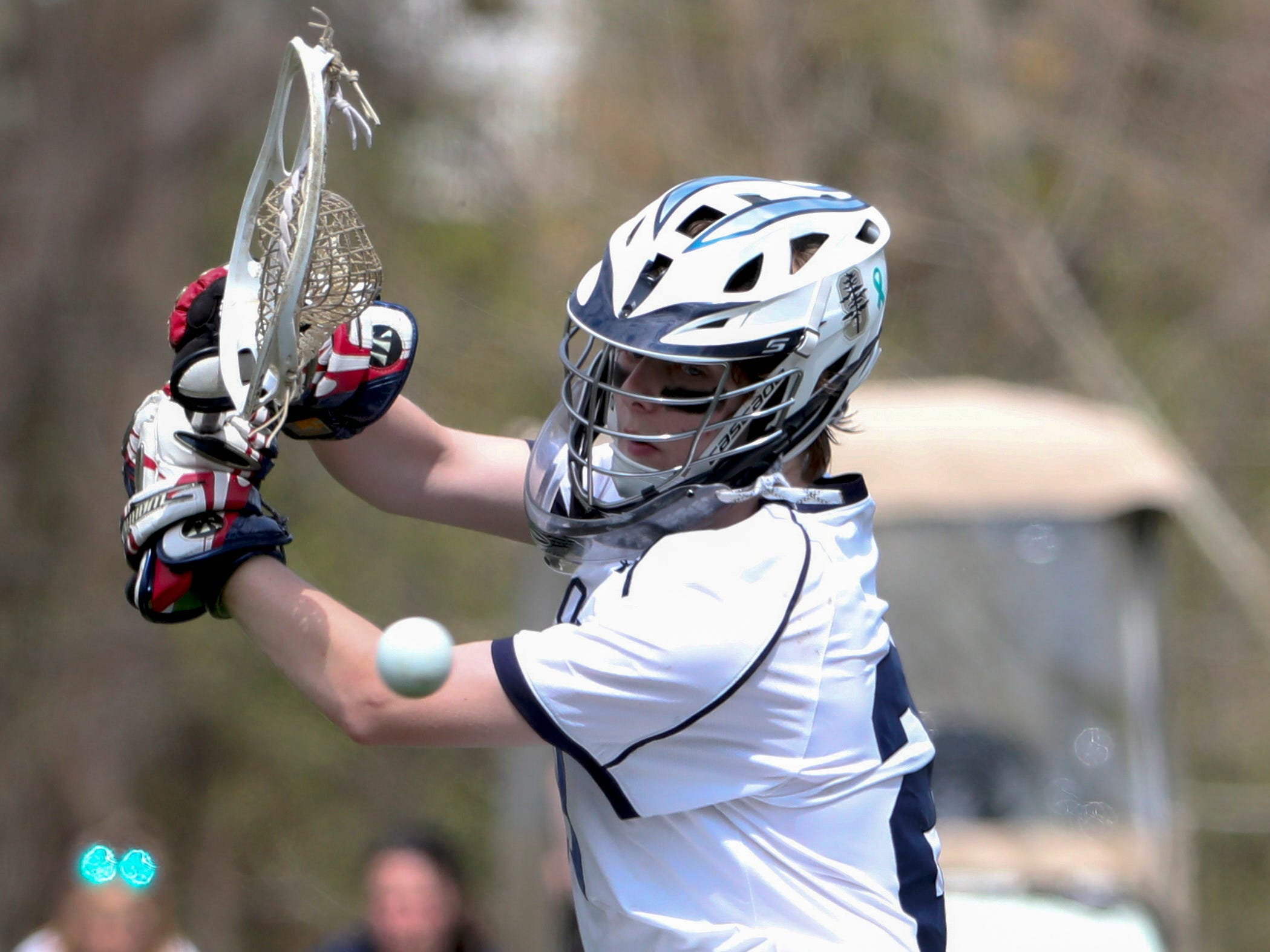 A shot goes wide of the net and Sanford goalie Owen Goodier in the second half of Sanford's 12-10 win Saturday.