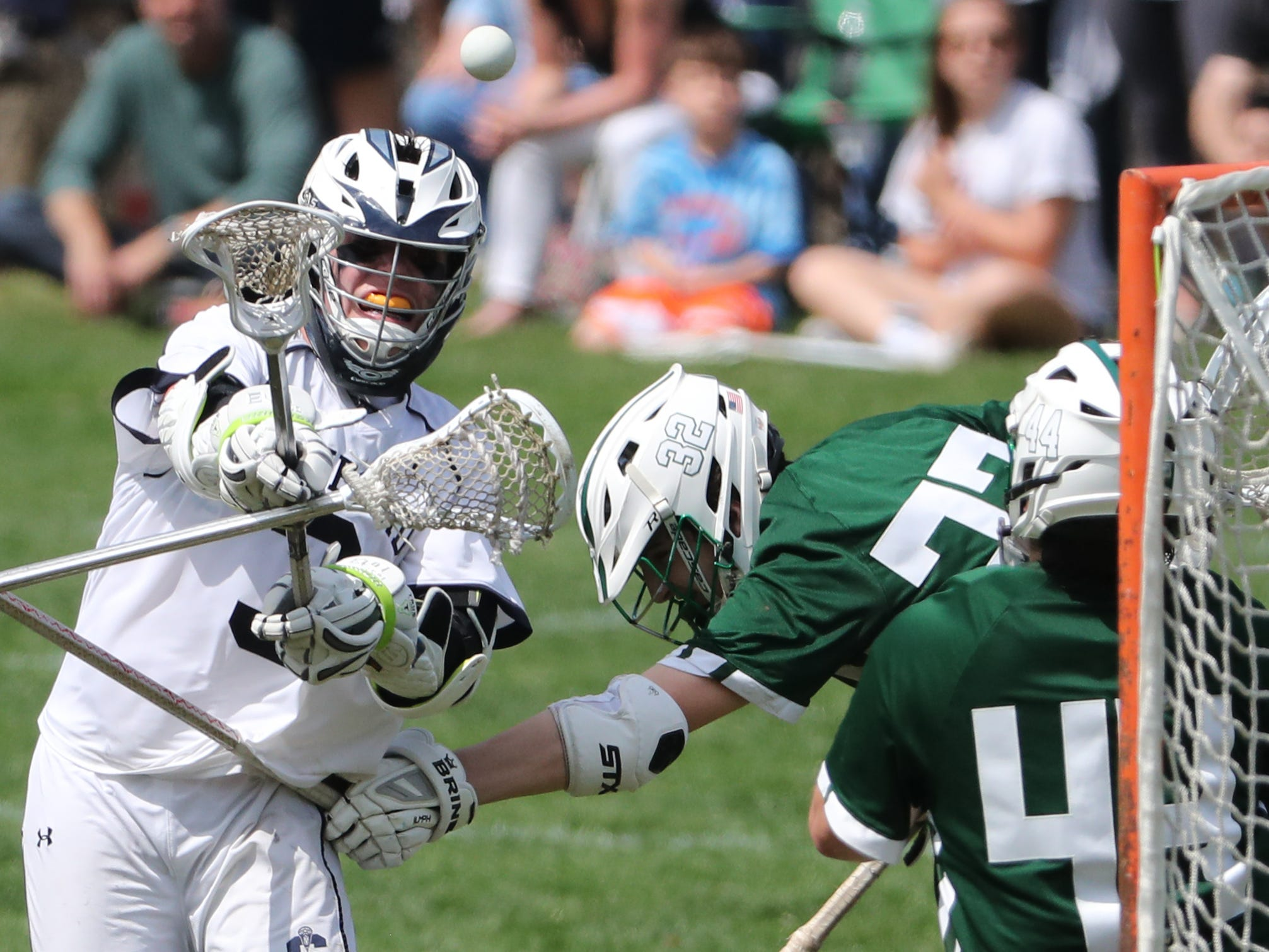 Sanford's Devon Lucky shoots and scores past Archmere's Connor Udovich and goalie Vaughn DiBattista for a late insurance goal and the final score of Sanford's 12-10 win Saturday.
