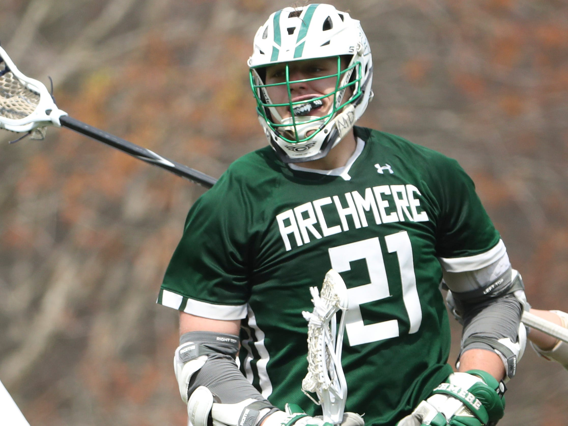 Archmere's Mitch Moyer celebrates a goal in the second half of Sanford's 12-10 win Saturday.