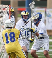 Delaware goalie Matt DeLuca watches as teammate Owen Grant takes the ball behind the net in the fourth period of Delaware's 13-7 win against Hofstra Saturday at Delaware Stadium.