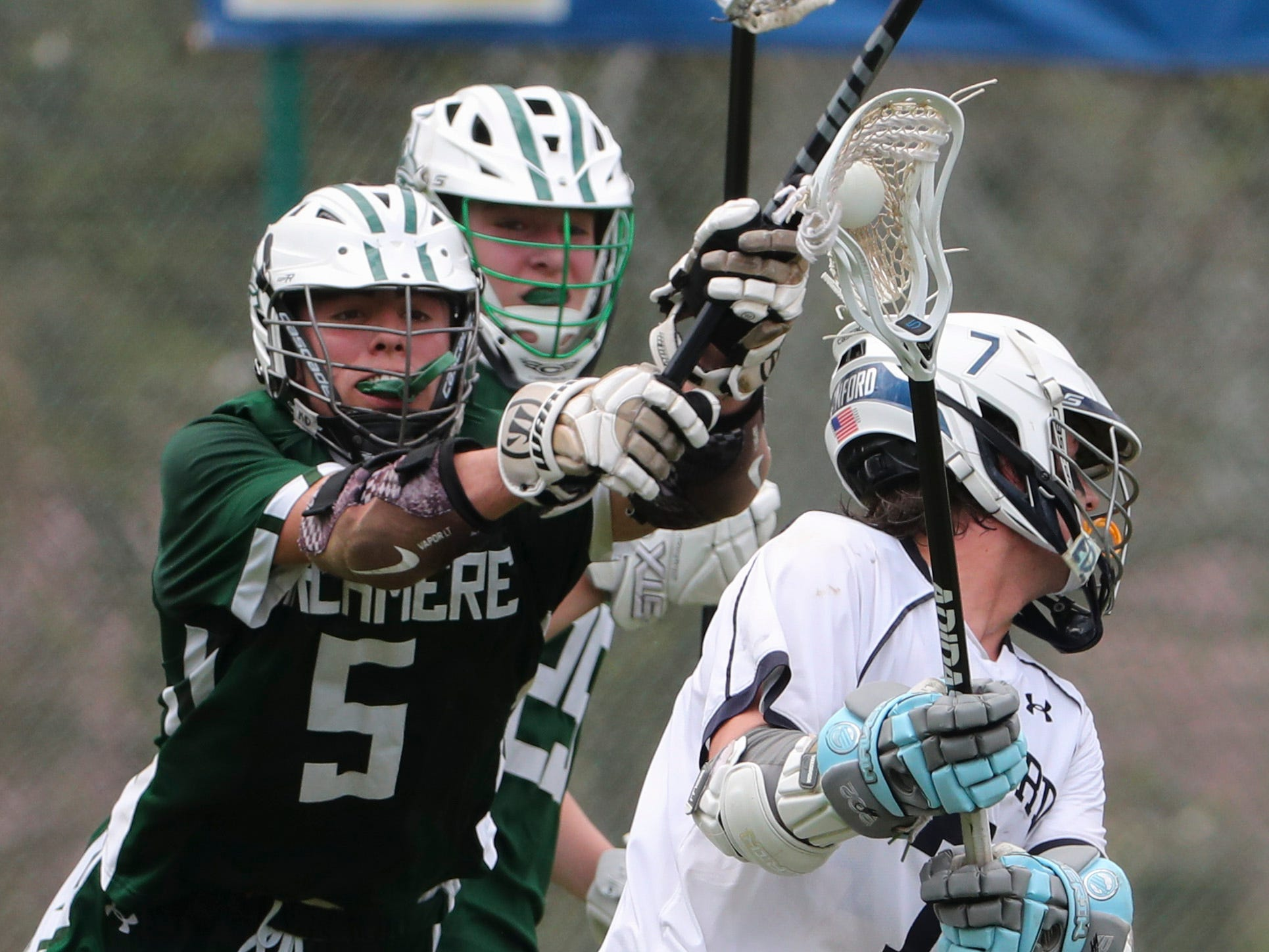 Archmere's Niall Marley reacts to try to stop a shot by Sanford's Tommy Bloom in the second half of Sanford's 12-10 win Saturday.