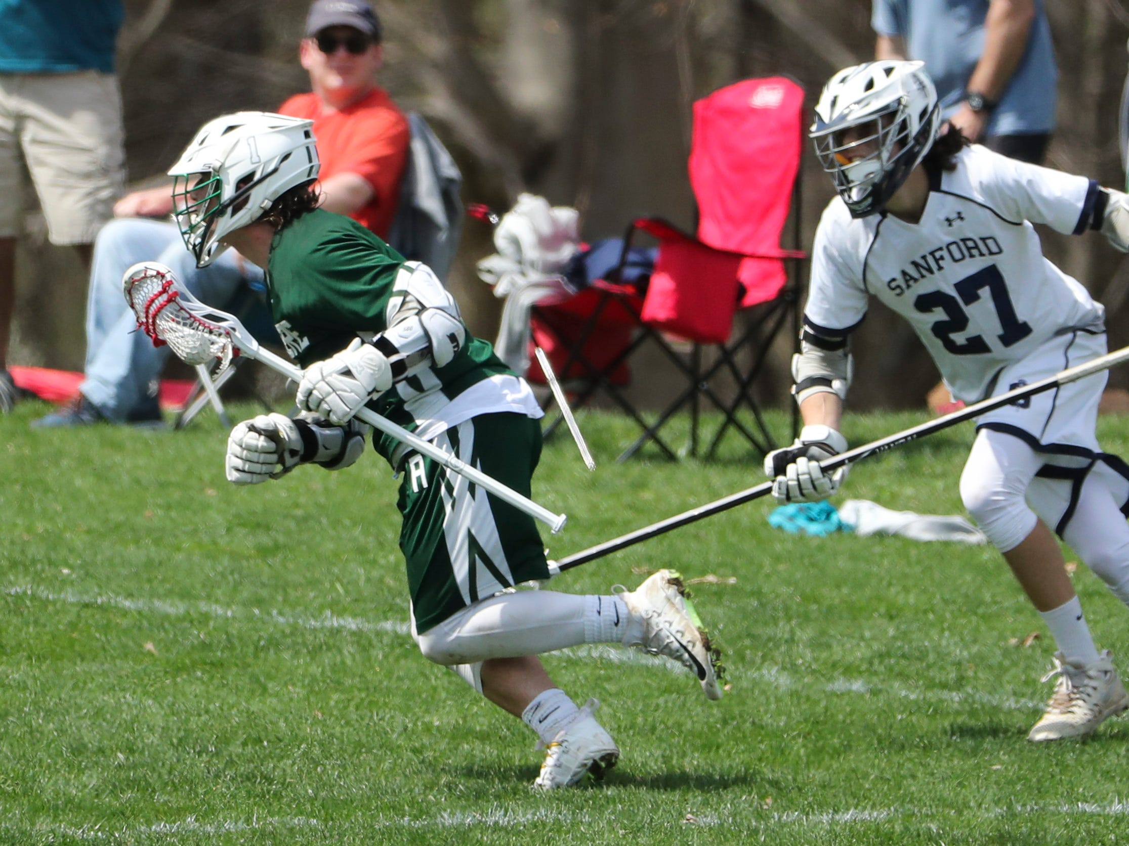 Archmere's Cole Bauer gets ahead of Sanford's Nathan LaMonte in the second half of Sanford's 12-10 win Saturday.