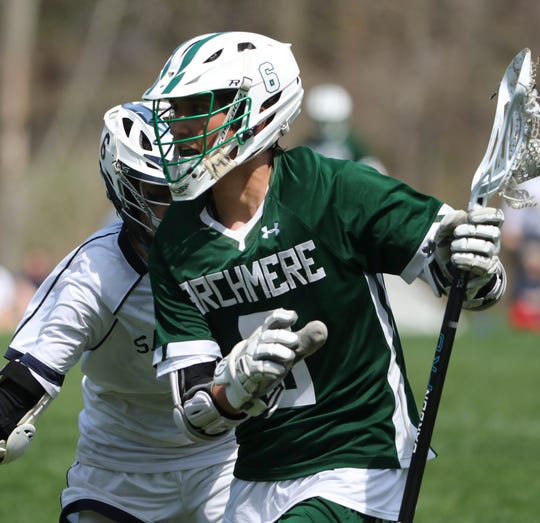 Archmere's Evan Hernick tries to get past Sanford's Collin Campbell in the second half of Sanford's 12-10 win Saturday.