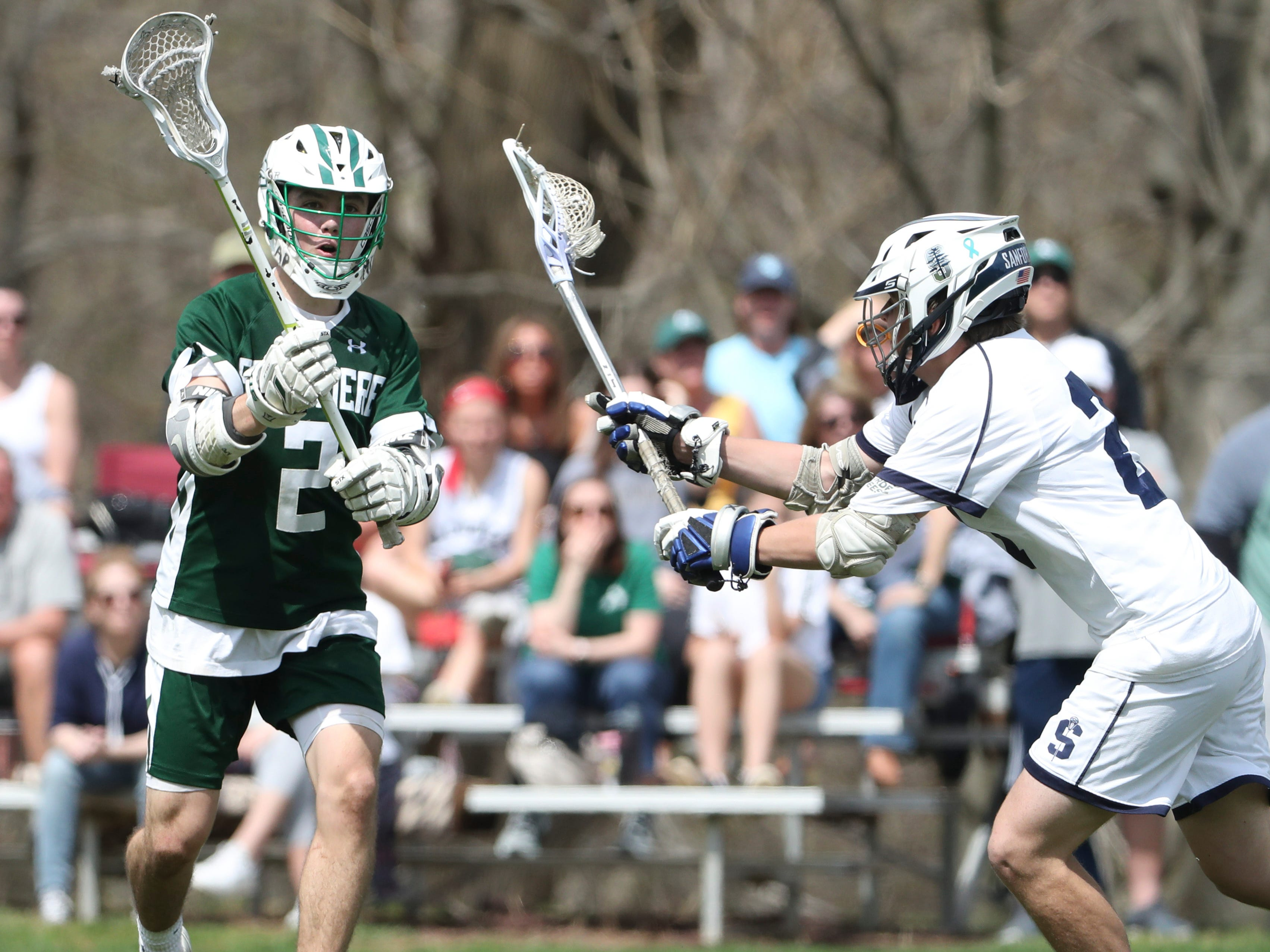 Archmere's Vincent Iannello (left) throws a pass past Sanford's Henry Bachtle in the second half of Sanford's 12-10 win Saturday.