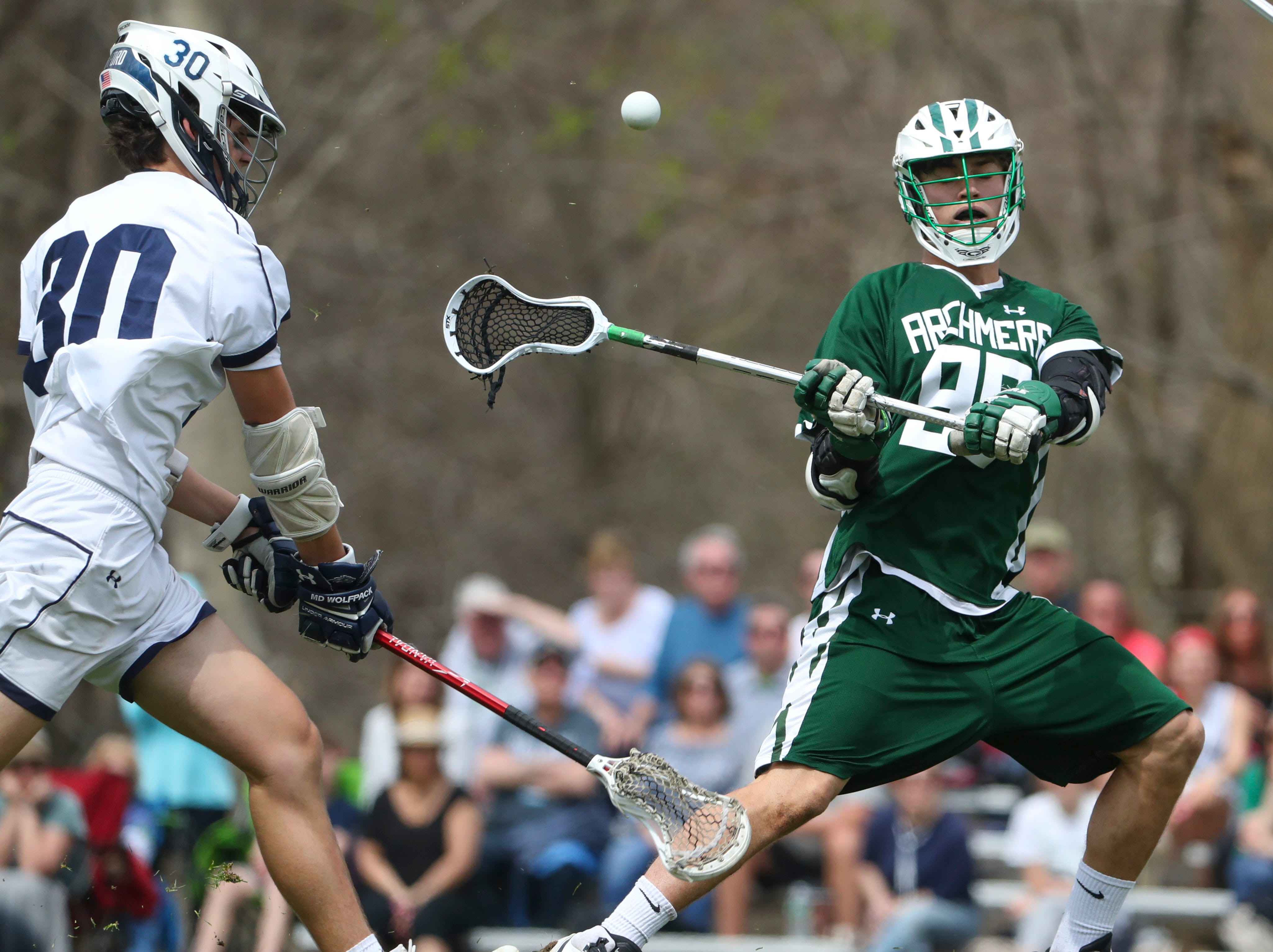 Archmere's Zane Fracek (right) passes as Sanford's Ian Binnersley defends in the second half of Sanford's 12-10 win Saturday.